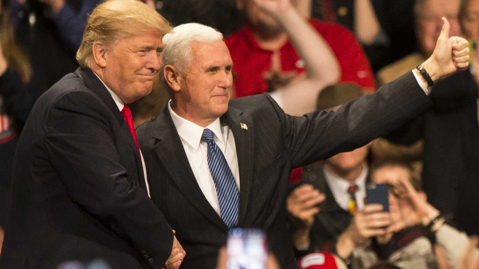 President-Elect Donald J. Trump and Vice President-Elect Mike Pence shake hands during an event in Des Moines on Thursday, Dec. 8, 2016. Trump and Pence are completing a Thank You tour across the country. (The Daily Iowan/Joseph Cress)