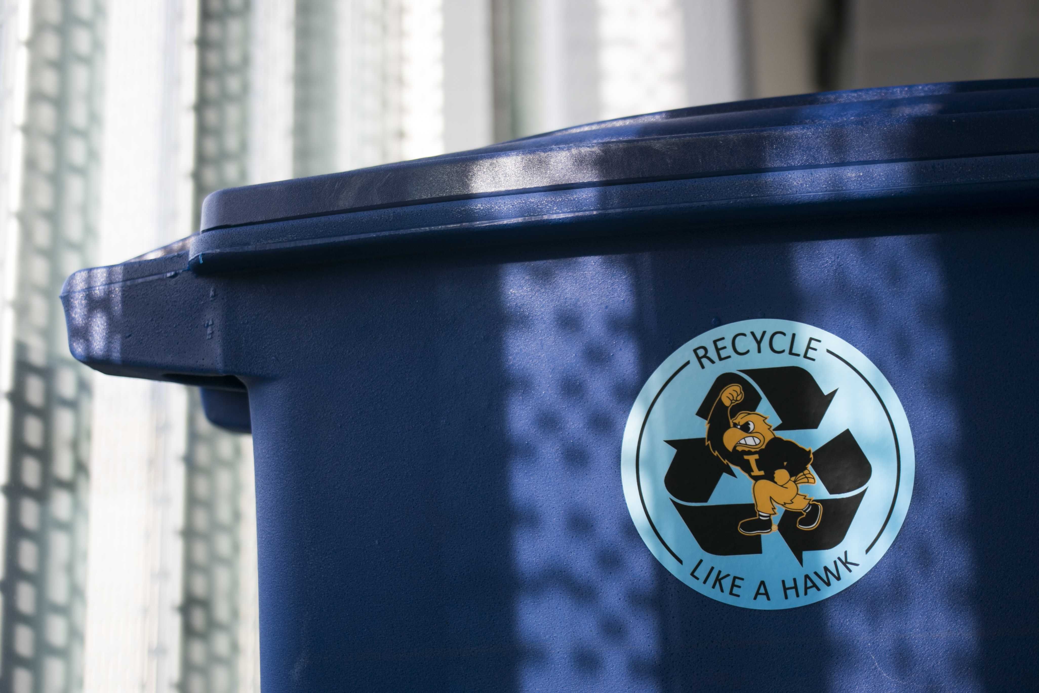 Blue recycling bins are seen inside the Seamans Center on Tuesday, Nov. 28, 2017. Seamans is in the process of undergoing a new recycling program to encourage students to recycle more recyclable products. (Joseph Cress/The Daily Iowan)