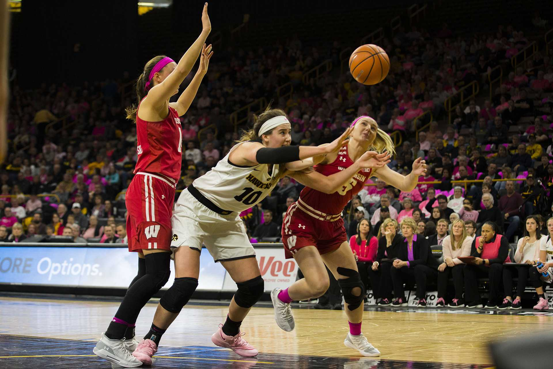 Iowa forward Megan Gustafson and Wisconsin guard Lexy Richardson dive for the ball during the Iowa/Wisconsin basketball game at Carver-Hawkeye Arena on Sunday, Feb. 18, 2018. The Hawkeyes defeated the Badgers, 88-61. (Lily Smith/The Daily Iowan)