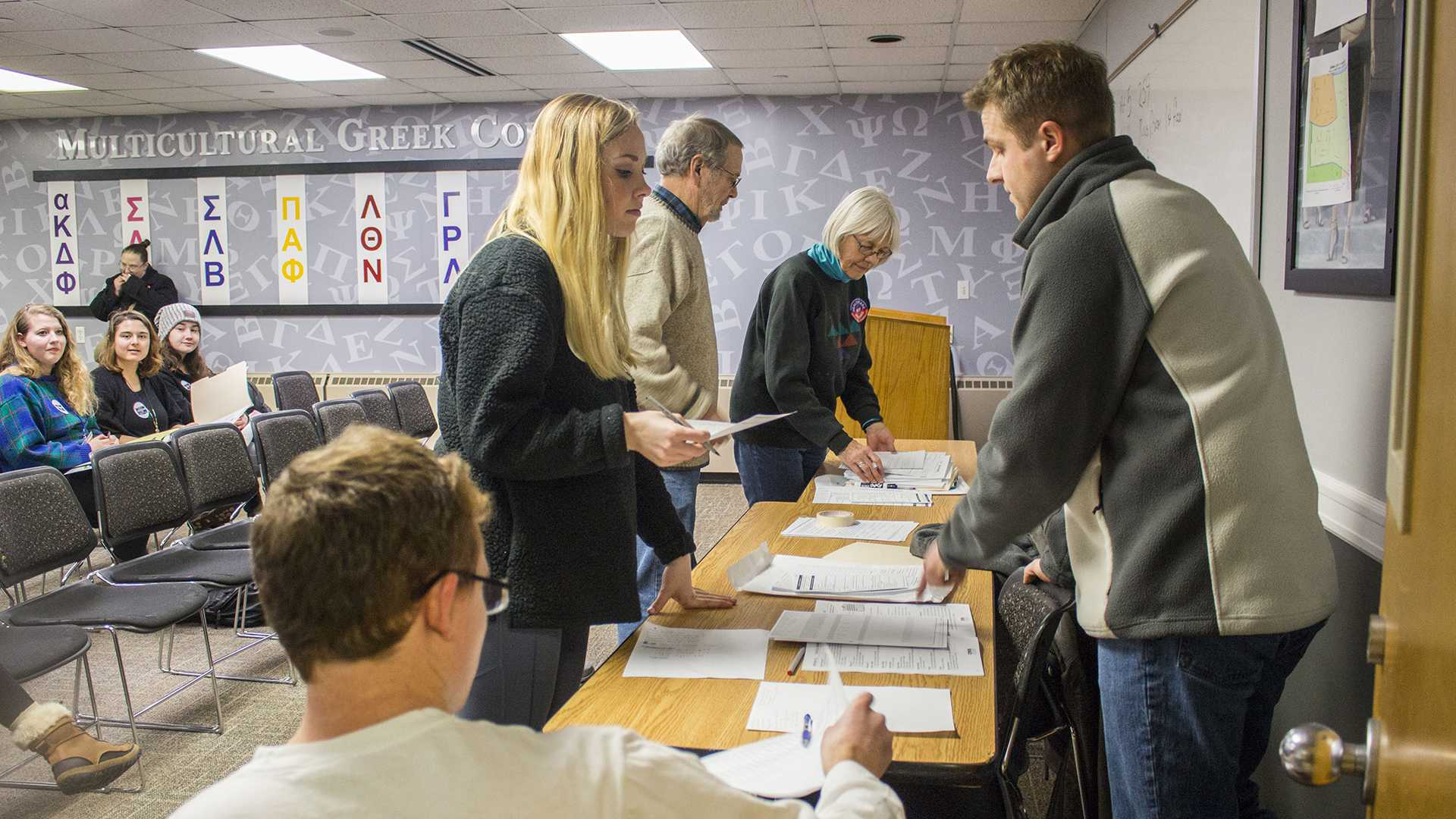 Precinct captains organize before calling precincts to order during the Iowa Democratic Caucus at the IMU on Monday, Feb. 5, 2018. The IMU contains 6 different precincts for Iowa City. (Lily Smith/The Daily Iowan)