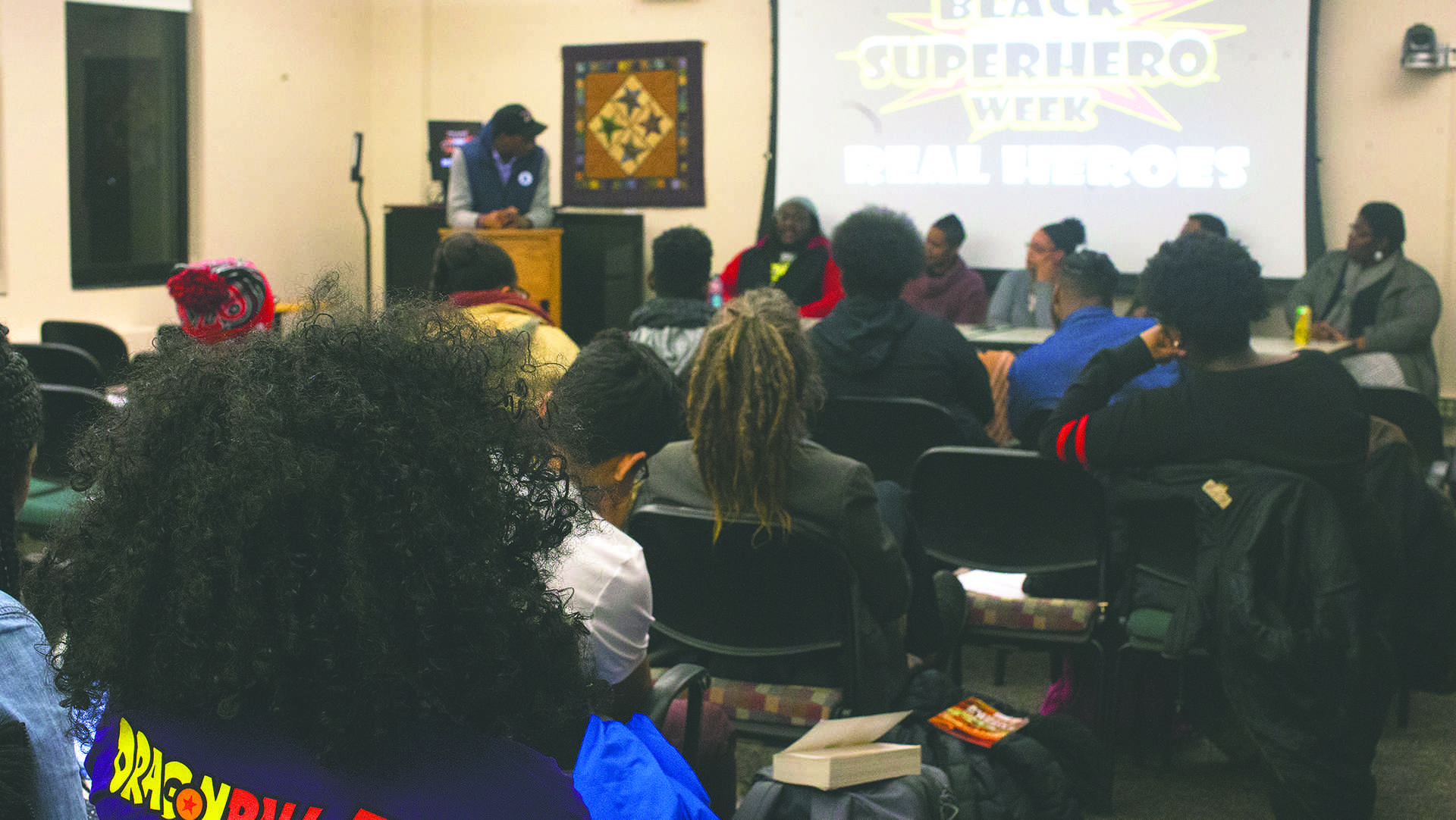 Audience listens during the Black Superhero Week talk on Feb. 13, 2018 in room 304 of the EPB. Five speakers were invited by Afro House to share with students the difference they are making around the Iowa City community, and to share their success. (Katie Goodale/The Daily Iowan)