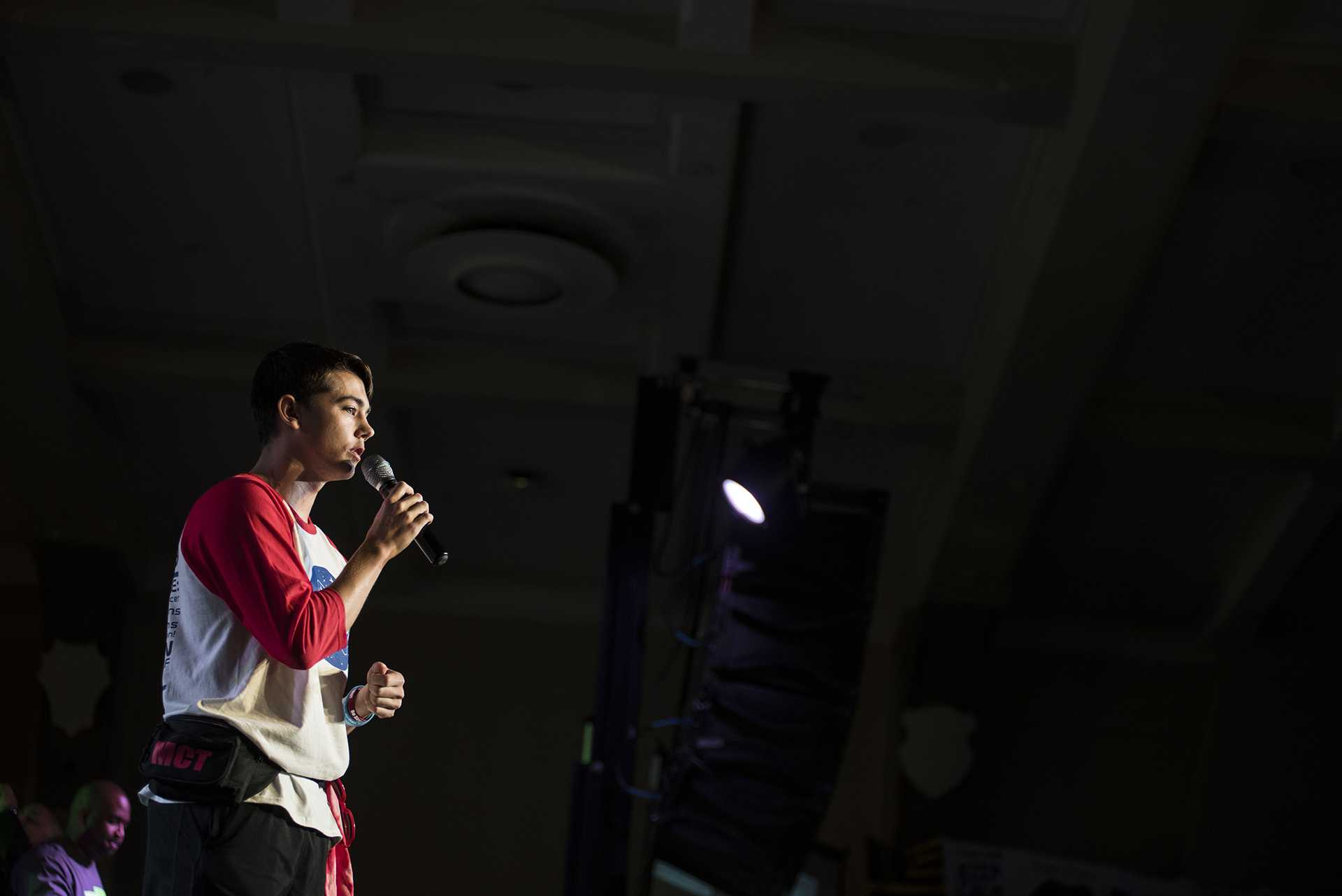 Dillyn Mumme, a survivor of leukemia, speaks to DM participants during the In the Limelight Talent Show at UI Dance Marathon 24 inside IMU on Saturday, Feb. 3, 2018. Mumme obtained a summer internship with the Johnson Space Center in Houston, TX this past year. He spoke about the differences between failing and failure as well as encouraged all members of the crowd to make an impact on the lives of those around them. (Ben Allan Smith/The Daily Iowan)