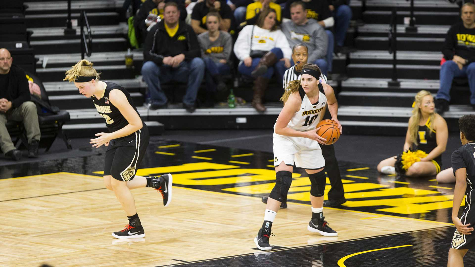 Iowa center Megan Gustafson pulls down a rebound during an Iowa/Purdue women's basketball game in Carver-Hawkeye Arena on Saturday, Jan. 13, 2018. The Boilermakers defeated the Hawkeyes, 76-70. (Joseph Cress/The Daily Iowan)