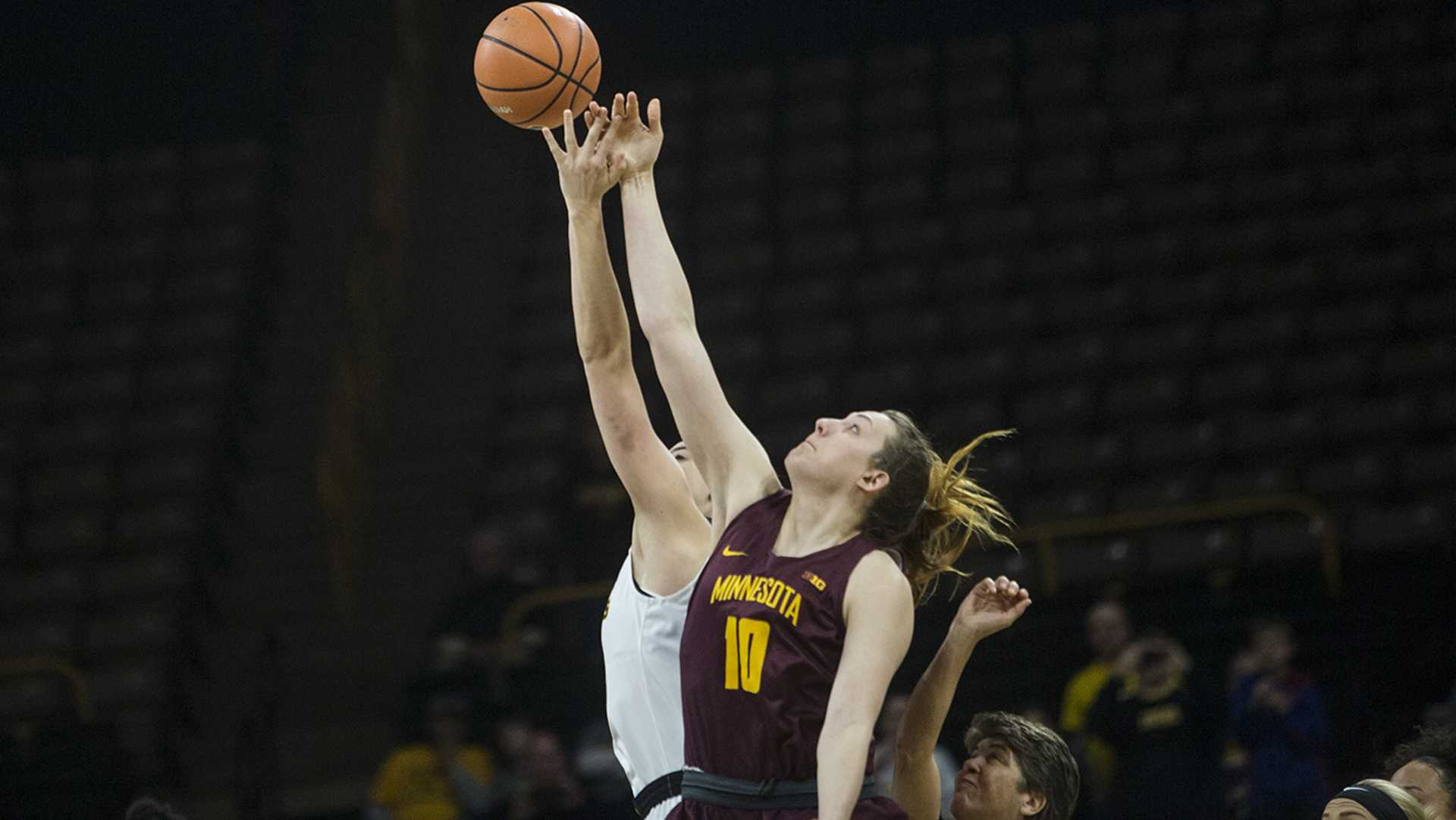 Iowa's Meghan Gustafson and Minnesota's Jessie Edwards tip-off during the Iowa vs. Minnesota basketball game at Carver-Hawkeye Arena on Sunday, Feb. 4, 2018. The Hawkeyes defeated the Golden Gophers 92-84.  (Chris Kalous/The Daily Iowan)