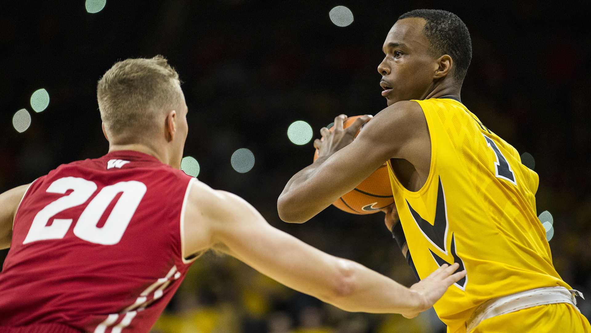 Iowa guard Maishe Dailey (1) looks for an open pass around Wisconsin's T.J. Schlundt (20) during the NCAA men's basketball game between Iowa and Wisconsin at Carver-Hawkeye Arena on Tuesday, Jan. 23, 2018. The Hawkeyes are going into the game with a conference record of 1-7. Iowa went on to defeat Wisconsin 85-67. (Ben Allan Smith/The Daily Iowan)