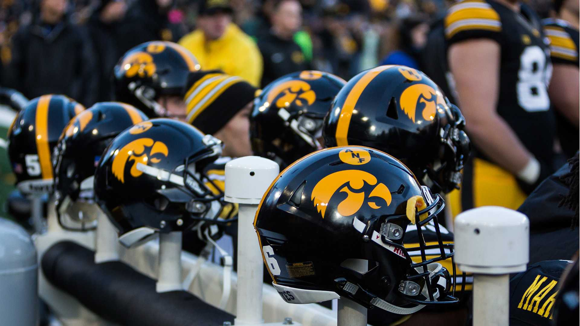 Iowa football helmets line the sidelines during a game against Purdue University on Saturday, Nov. 18, 2017. The Boilermakers defeated the Hawkeyes 24 to 15. (David Harmantas/The Daily Iowan)