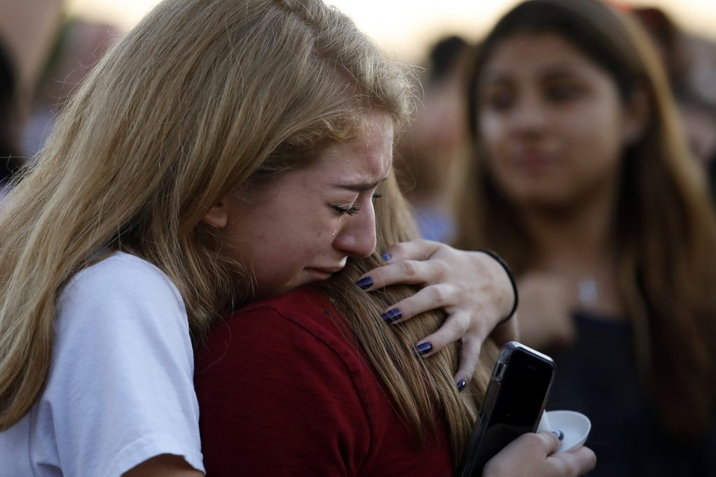 Mourners+gather+at+a+vigil+for+the+victims+of+the+mass+shooting+at+Marjory+Stoneman+Douglas+High+School+in+Parkland%2C+Fla.%2C+on+Thursday%2C+Feb.+15%2C+2018.+%28Carolyn+Cole%2FLos+Angeles+Times%2FTNS%29