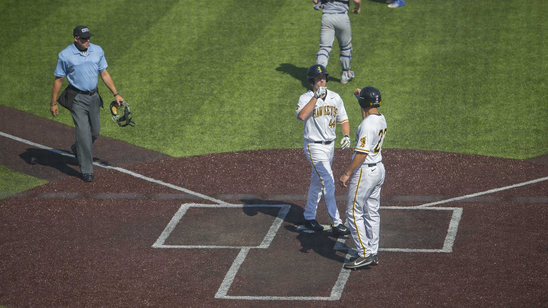 Iowa outfielder Robert Neustrom celebrates a run during the Iowa/Ontario baseball game at Duane Banks Field on Saturday, Sept. 23, 2017. The Hawkeyes defeated the Blue Jays, 17-2. (Lily Smith/The Daily Iowan)