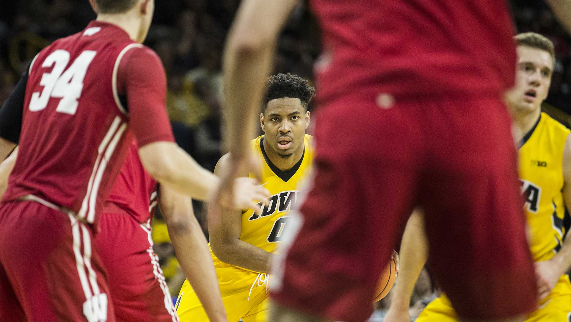 Iowa forward Ahmad Wagner (0) looks for an open pass during the NCAA men's basketball game between Iowa and Wisconsin at Carver-Hawkeye Arena on Tuesday, Jan. 23, 2018. The Hawkeyes are going into the game with a conference record of 1-7. Iowa went on to defeat Wisconsin 85-67. (Ben Allan Smith/The Daily Iowan)