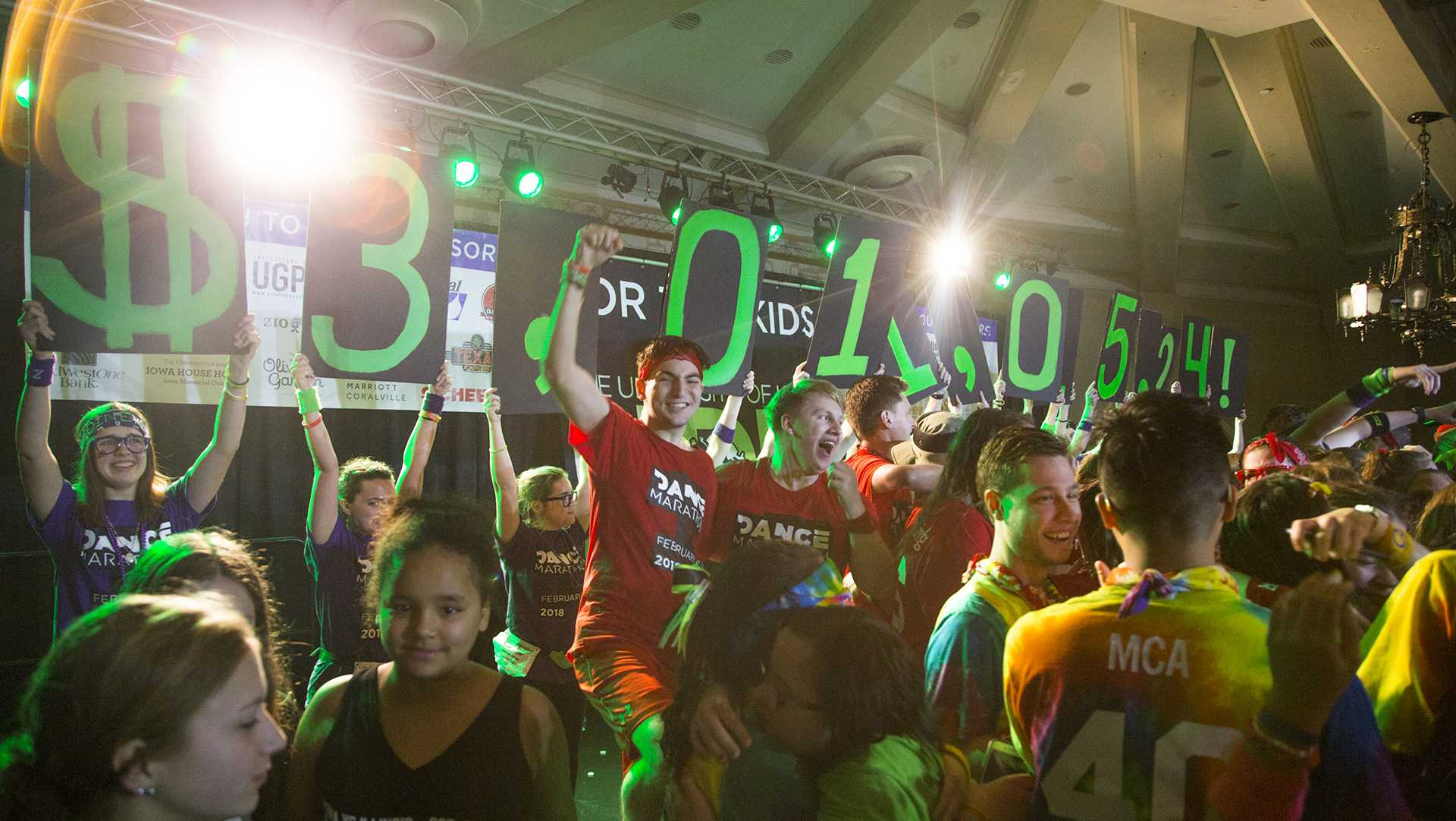 The Big Reveal shows a UI-record breaking amount of $3,011,015.24 for Dance Marathon 24 in the IMU on Saturday, Feb. 3, 2018. (Lily Smith/The Daily Iowan)
