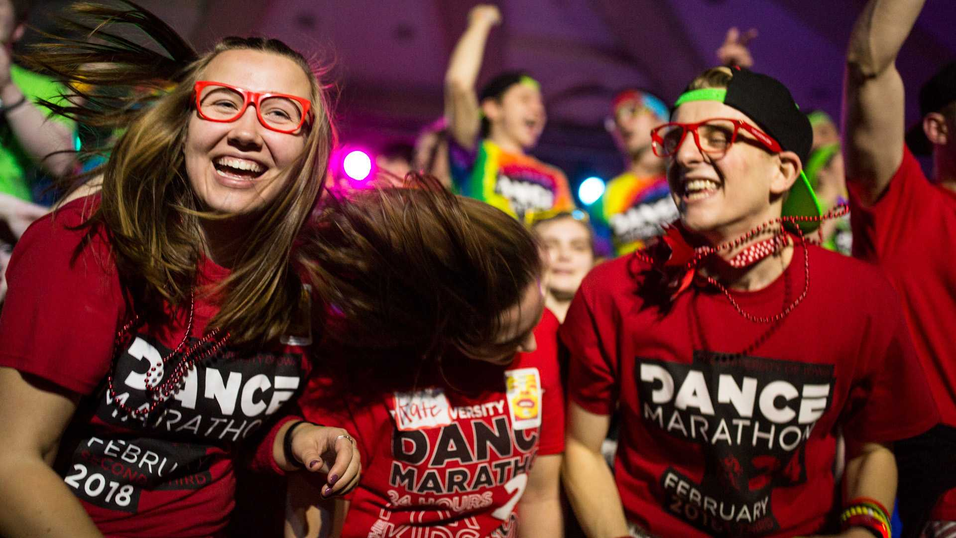 Dance marathon participants dance on stage during the ninth hour of the University of Iowa 24th Annual Dance Marathon, on Saturday, Feb. 3, 2018. (David Harmantas/The Daily Iowan)