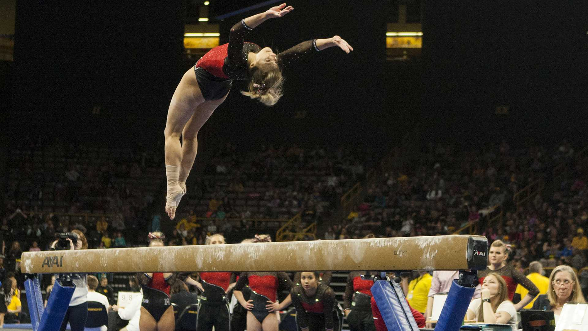 Nebraska's Megan Schweihofer performs on beam during the Iowa/Nebraska meet at Carver-Hawkeye Arena on Saturday, Feb. 10, 2018. The Cornhuskers defeated the Hawkeyes with 195.675 to 194.900.  (Ashley Morris/The Daily Iowan)