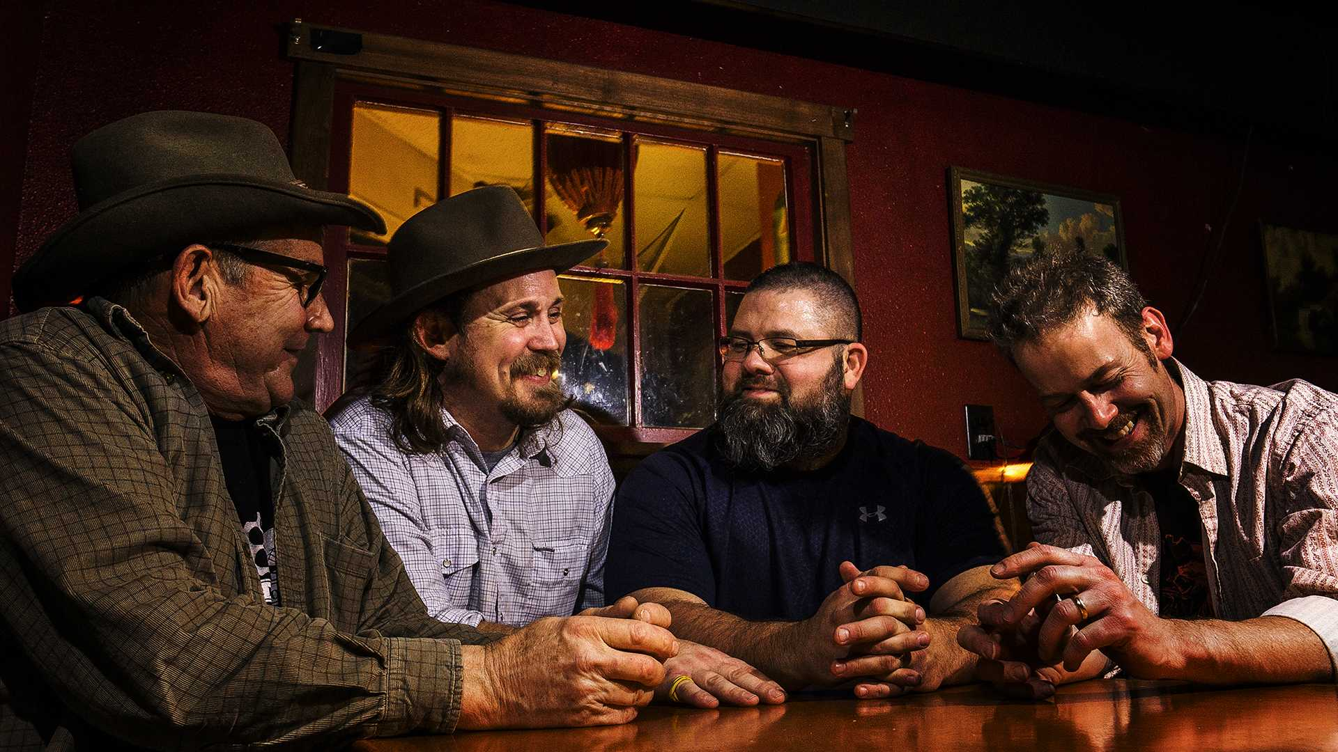 Tim Buhmeyer, Eric Pettit, Micah Oleson, and Ed Manseim pose for a group photo shortly after performing of the Eric Pettit Lions at The Mill on Friday, Feb. 9, 2017. The group hails from Burlington, Iowa and considers themselves as weekend warriors with their unique blend of old timey folk music. (James Year/The Daily Iowan)