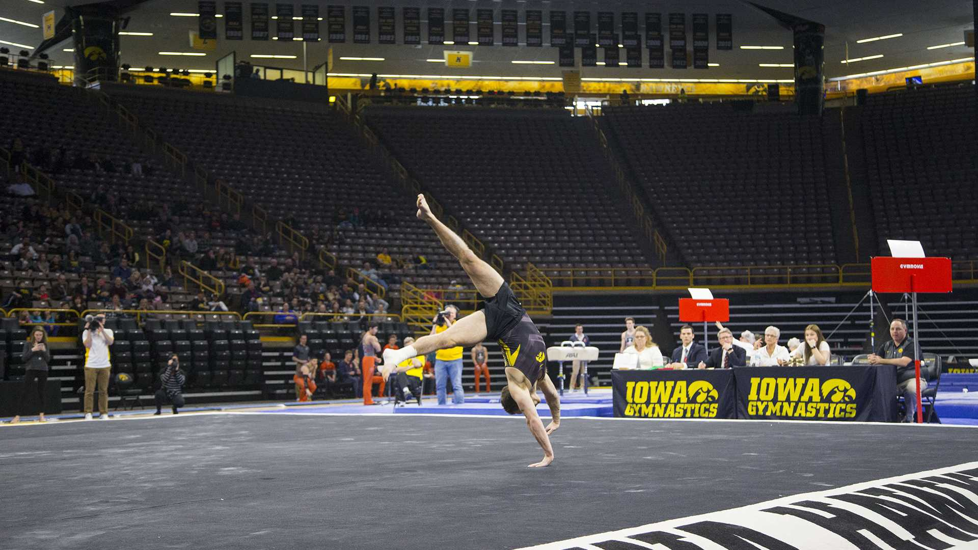 Iowa's Dylan Ellsworth performs on the floor during the Iowa/Illinois men's gymnastics meet on Saturday, Feb. 3, 2018. Ellsworth scored 13.530 on floor. The Fighting Illini defeated the Hawkeyes, 404.700-401.850. (Lily Smith/The Daily Iowan)