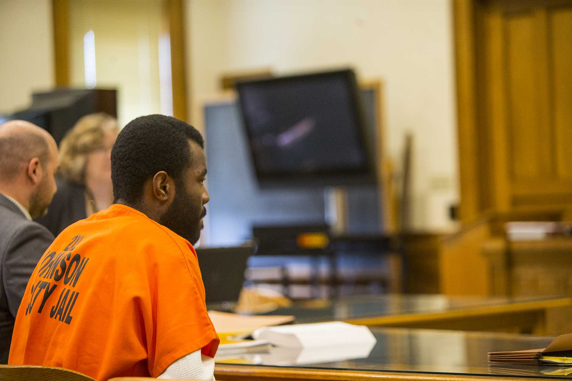 """Lamar Wilson of Iowa City sits in the court room during a case management hearing for Lamar Wilson vs. Johnson County in the Johnson County courthouse on Friday, Oct. 27, 2017. Wilson's lawyers asked the judge to dismiss charges against him using Iowa's """"stand your ground"""" defense. (Joseph Cress/The Daily Iowan)"""