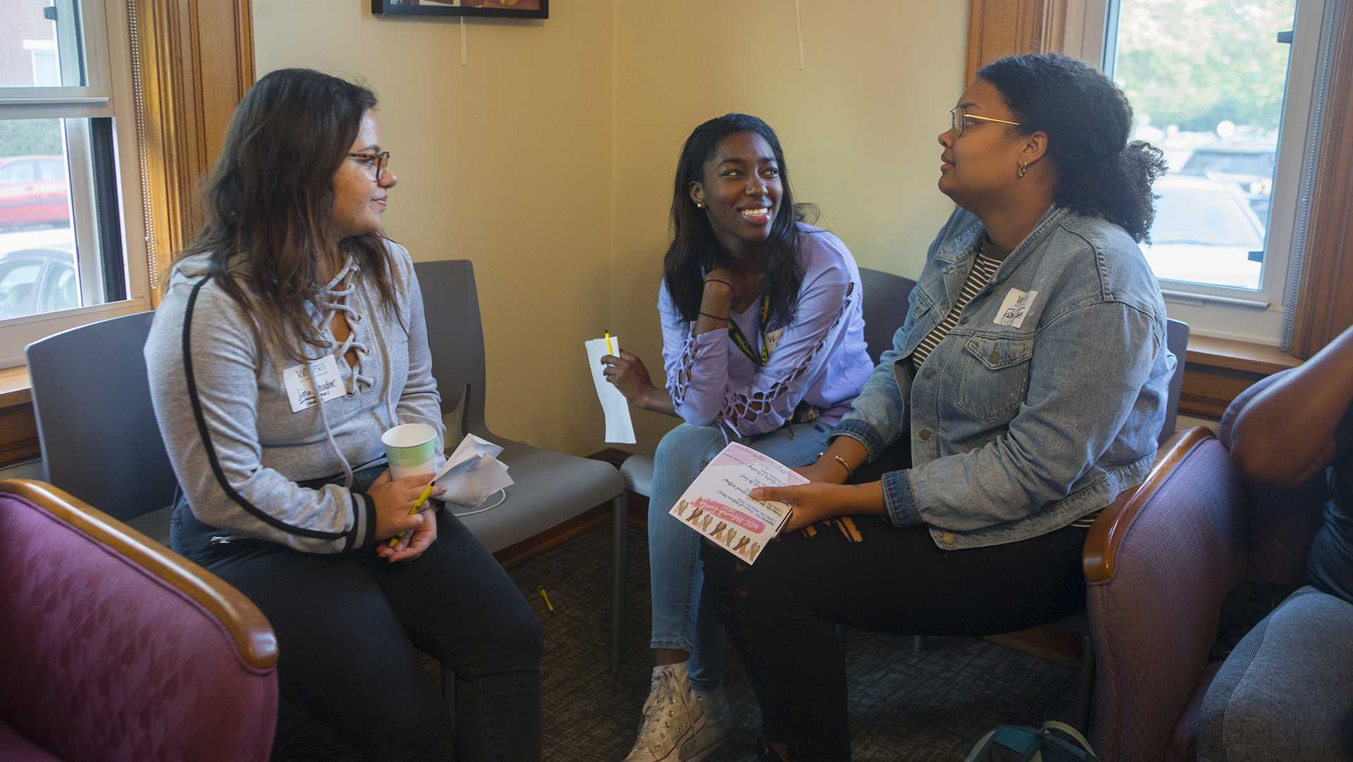 From left: UI students Lina Khodor, Felicia Ogunsanya, and Fatima Tall mingle during the Womxn of Colour Welcome Mixer at the Women's Resource and Action Center on Wednesday, Sep. 6, 2017. It was the inaugural event for the Womxn of Colour Network Series, and will feature a monthly program on a topic affecting womxn of color. (Lily Smith/The Daily Iowan)