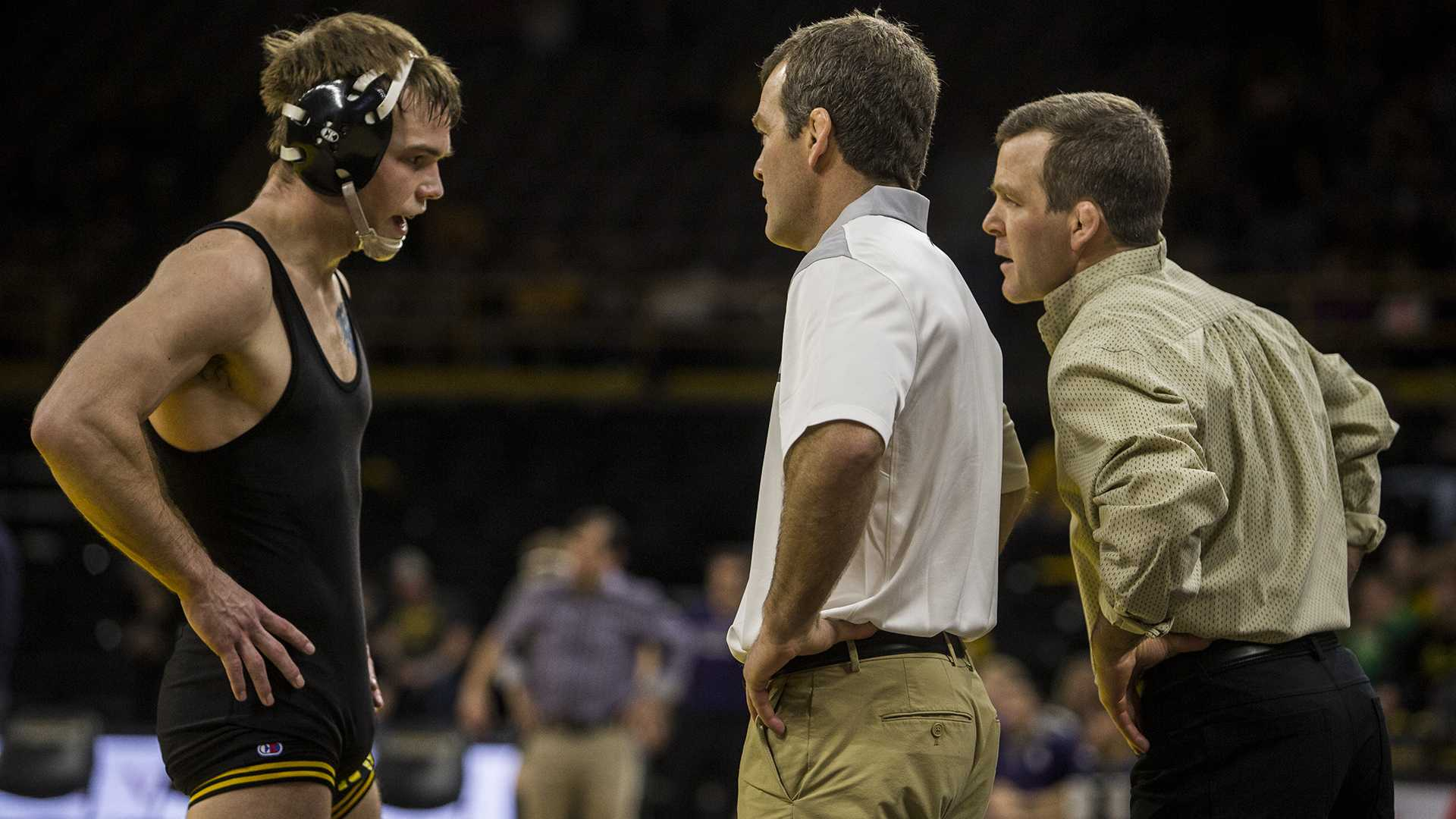 Iowa's number 2 ranked 159 pund wrestler Brandon Sorenson talks to head coaches Tom and Terry Brands during the Iowa vs. Northwestern dual meet on Sunday, Feb. 4, 2018. Sorenson won his match 5-4 to close out his home career as a Hawkeye and the Hawkeyes defeated the wildcats 33-2. (Nick Rohlman/The Daily Iowan)