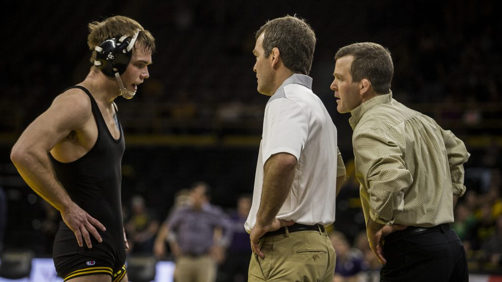 Iowa+Head+Coaches+Tom+and+Terry+Brands+speak+with+%232+ranked+149+pound+wrestler+Brandon+Sorenson+during+the+Iowa+vs.+Northwestern+dual+meet+on+Sunday%2C+Feb.+4%2C+2018.+The+Hawkeyes+defeated+the+wildcats+33-2.+%28Nick+Rohlman%2FThe+Daily+Iowan%29