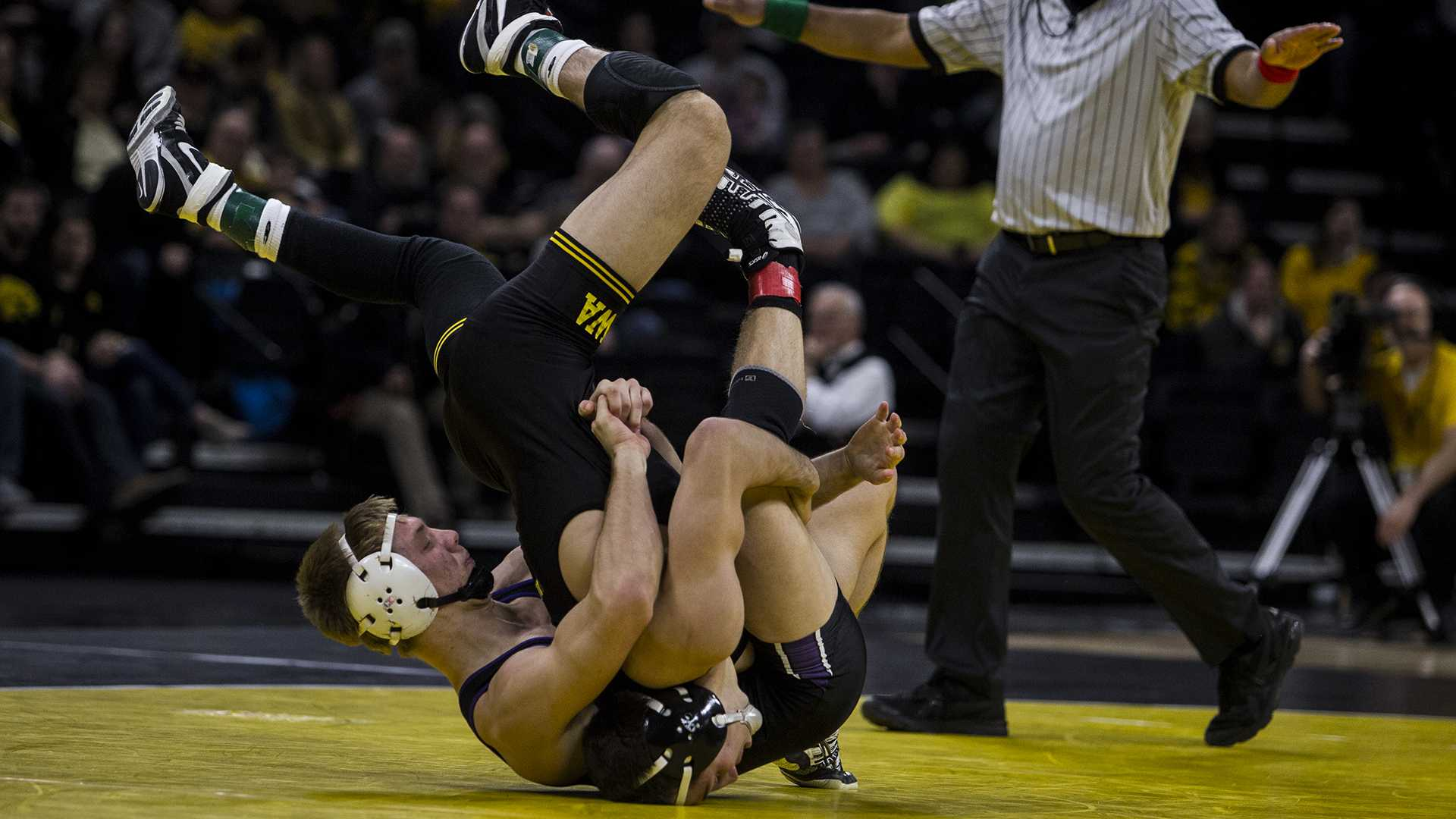 Iowa's #2 ranked Michael Kemerer wrestles Northwestern's Shane Oster during the Iowa vs. Northwestern dual meet on Sunday, Feb. 4, 2018. Kemerer won a tech fall, 17-2. The Hawkeyes defeated the wildcats 33-2. (Nick Rohlman/The Daily Iowan)