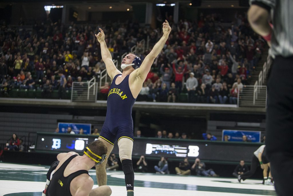 Michigan%27s+165-pound+Logan+Massa+celebrates+a+victory+over+Iowa%27s+Alex+Marinelli+during+Big+Ten+Wrestling+Championships+Day+1+at+the+Breslin+Student+Events+Center+in+East+Lansing%2C+MI+on+Saturday%2C+Mar.+3%2C+2018.+%28Ben+Allan+Smith%2FThe+Daily+Iowan%29