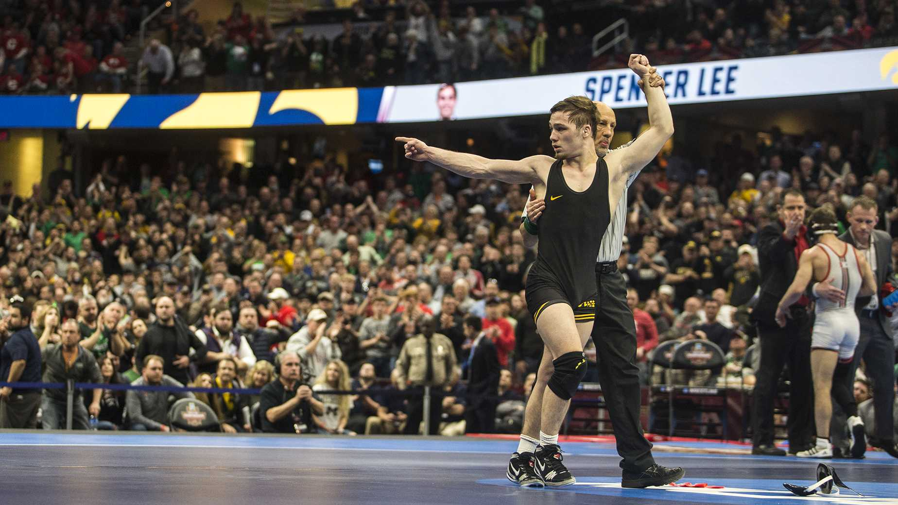 Iowa's Spencer Lee defeats Rutgers's Nick Suriano in the 125-pound final bout of the NCAA Wrestling Championships in Cleveland, OH. Lee beat Suriano by decision, 5-1. This is Lee's first national title. (Ben Allan Smith/The Daily Iowan)
