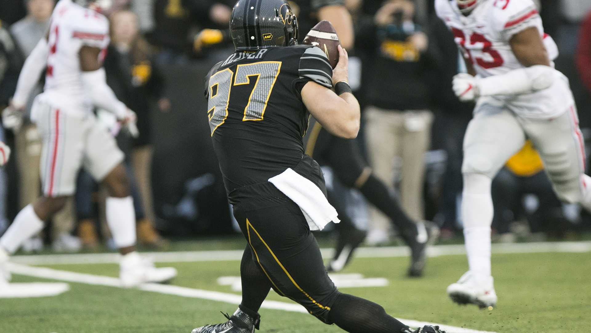 Iowa long snapper Tyler Kluver makes a reception off of a trick play on fourth down during the Iowa/Ohio State football game in Kinnick Stadium on Saturday, Nov. 4, 2017. The Hawkeyes defeated the Buckeyes in a storming fashion, 55-24. (Joseph Cress/The Daily Iowan)