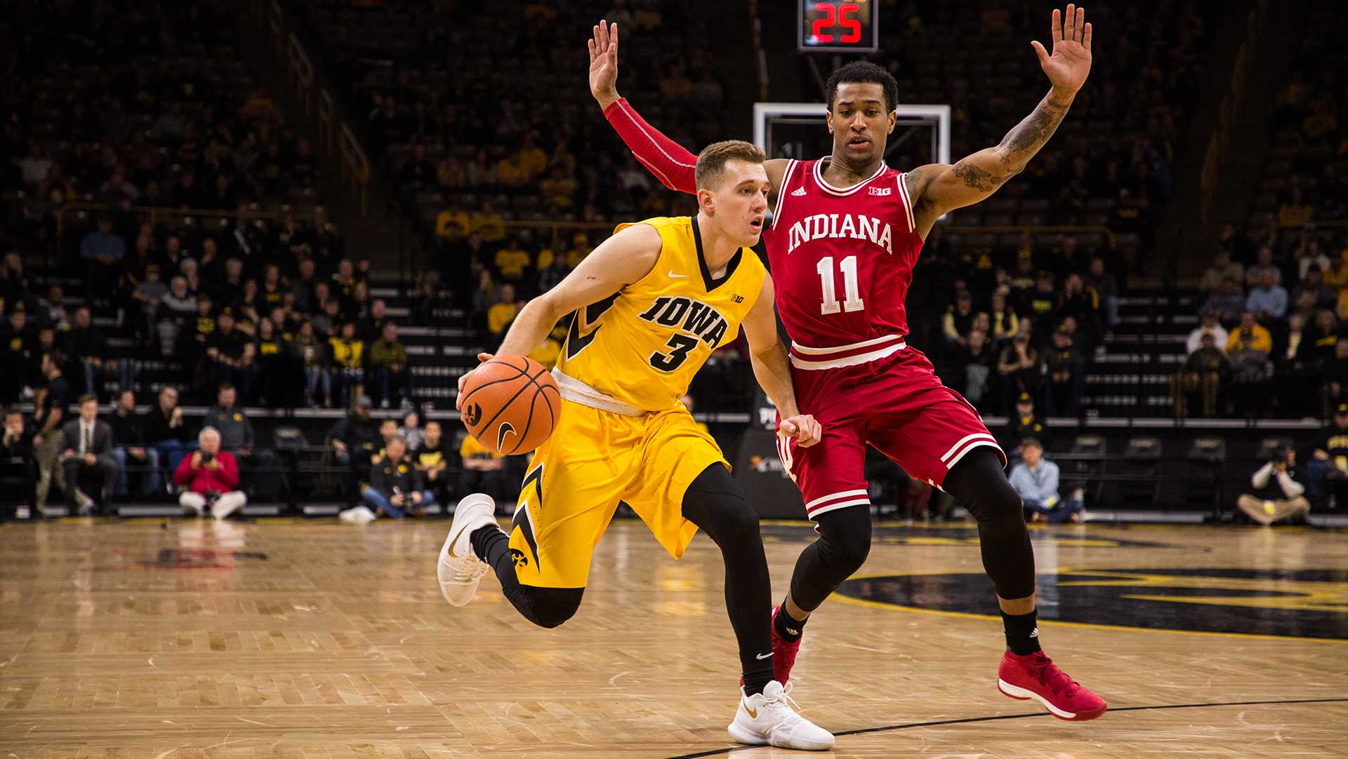 Iowa guard Jordan Bohannon drives the ball up court against Indiana University at Carver-Hawkeye Arena on Saturday, Feb. 17, 2018. The Hoosiers defeated the Hawkeyes 84 to 82. (David Harmantas/The Daily Iowan)