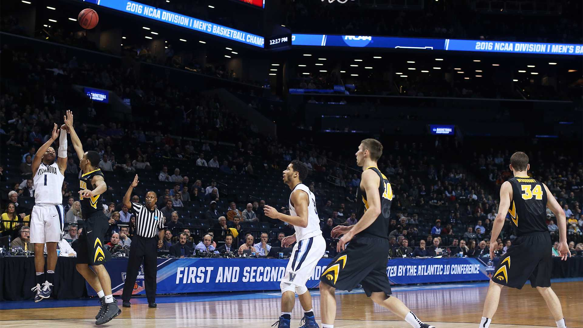 Villanova Wildcats guard Jalen Brunson (1) shoots a three against Iowa Hawkeyes guard Christian Williams (11) in the Barclays Center on Sunday, March 20, 2016 in Brooklyn, New York. Brunson ended the game with 3 rebounds, 12 points, and 4 assists. The Wildcats defeated the Hawkeyes, 87-68. (The Daily Iowan/Joshua Housing)