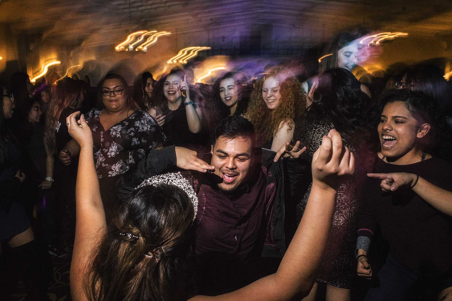 UI Sophomore Mayte Gomez-Cruz dances with the crowd during a mock Quinceañera celebration at the IMU on Thursday, Mar. 22nd, 2018. A Quinceañera is a coming of age ceremony in hispanic communities to mark a woman's 15th birthday. (James Year)