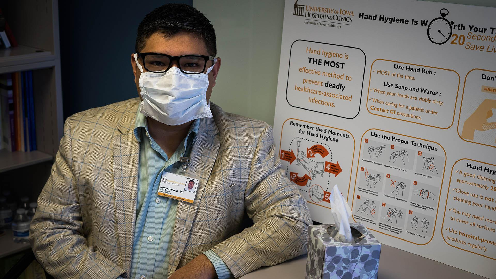 University of Iowa Clinical Assistant Professor Dr. Jorge Salinas poses for a portrait in his office on Wednesday, March 7. Salinas is an Infectious Disease Specialist at the University of Iowa. (Matthew Finley/The Daily Iowan)