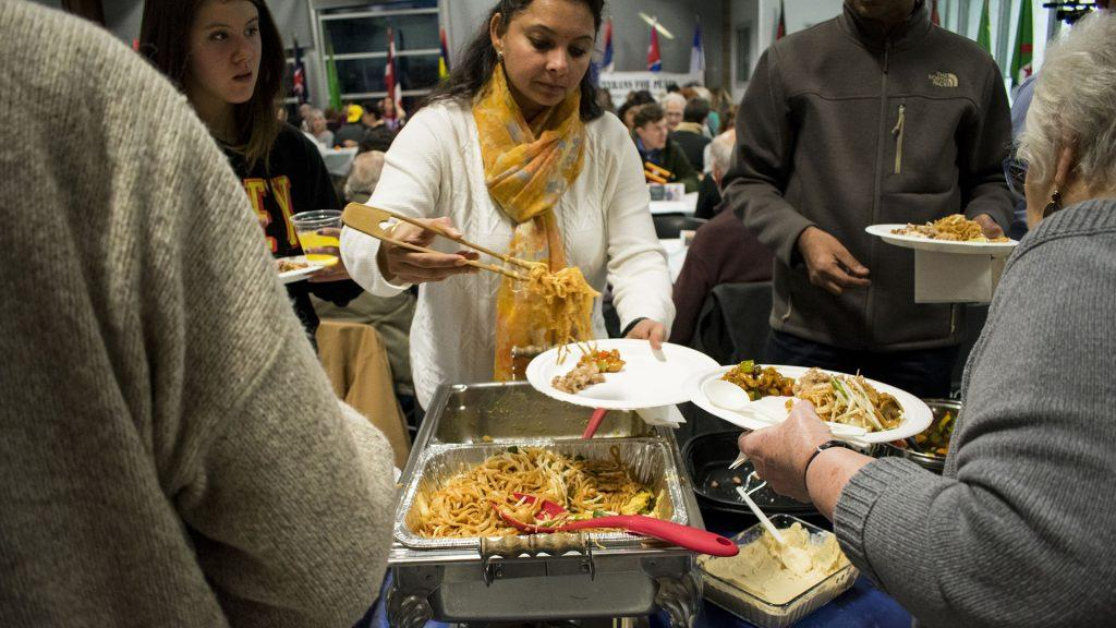 The+annual+Night+of+1000+Dinners+was+held+at+the+Robert+E.+Lee+Recreation+Center+on+Wednesday%2C+March+7%2C+2018.+The+event+was+centered+around+improving+the+lives+of+children+in+refugee+camps%2C+and+all+funds+raised+at+the+event+will+go+to+the+Shabele+Primary+School+in+the+Kakuma+Refugee+Camp+in+Kenya.+%28Sid+Peterson%2FDaily+Iowan%29