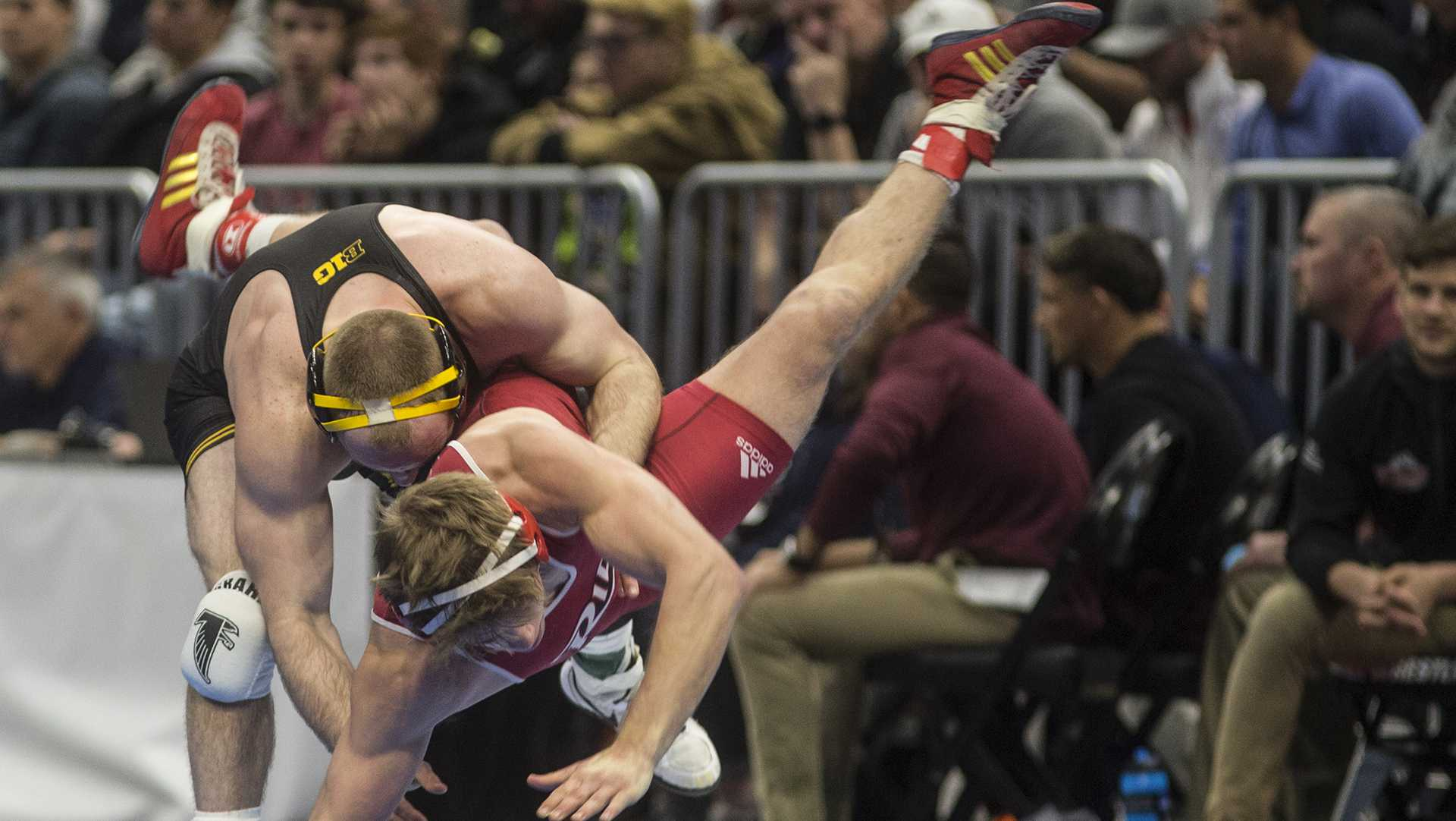Iowa's 165-pound Alex Marinelli takes down Riders's Chad Walsh during Session 3 of the NCAAs Wrestling Championships at Quicken Loans Arena in Cleveland, OH on Thursday, March 16, 2018. Marinelli defeated Walsh by decision 7-6, advancing to the semifinals. (Ben Allan Smith/The Daily Iowan)