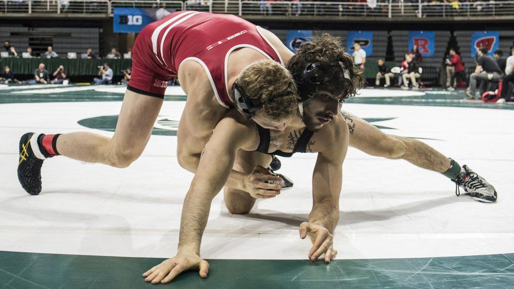 Wisconsin%27s+141-pound+Eli+Stickley%2C+left%2C+scores+two+on+Iowa%27s+Vince+Turk+during+Big+Ten+Wrestling+Championships+Day+1+at+the+Breslin+Student+Events+Center+in+East+Lansing%2C+MI+on+Saturday%2C+Mar.+3%2C+2018.+%28Ben+Allan+Smith%2FThe+Daily+Iowan%29