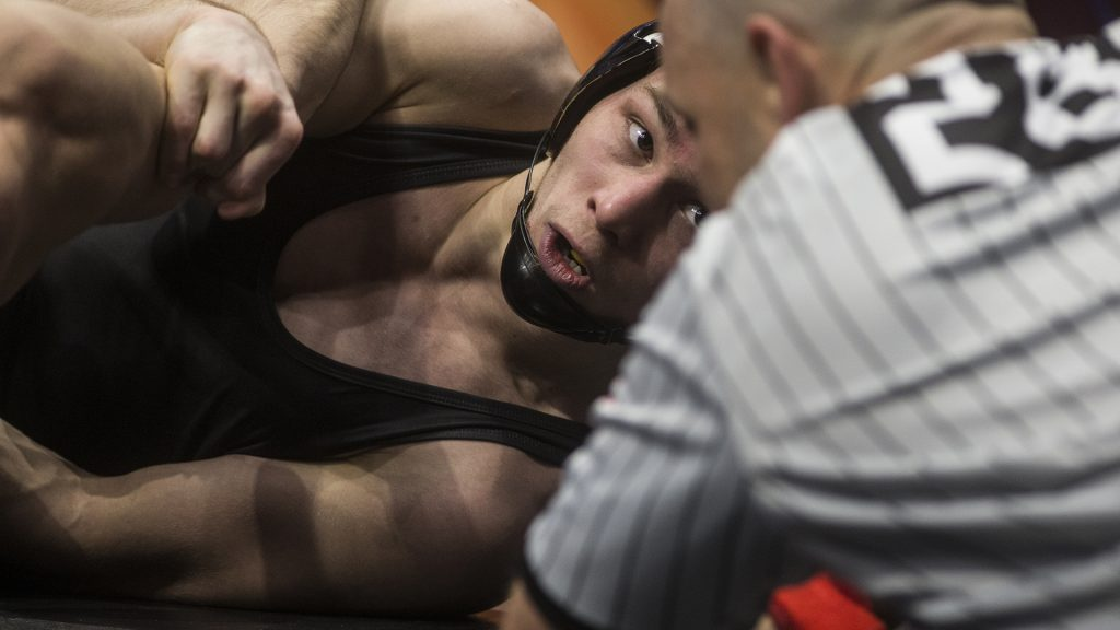 Iowa%27s+125-pound+Spencer+Lee+looks+to+the+ref+during+his+match+against+Purdue%27s+Luke+Welch+in+Session+2+of+the+NCAA+Division+1+Wrestling+Championships+at+Quicken+Loans+Arena+in+Cleveland%2C+Ohio+on+Thursday%2C+March+15%2C+2018.+Lee+beat+Welch+by+tech+fall+in+3%3A59.+%28Ben+Allan+Smith%2FThe+Daily+Iowan%29