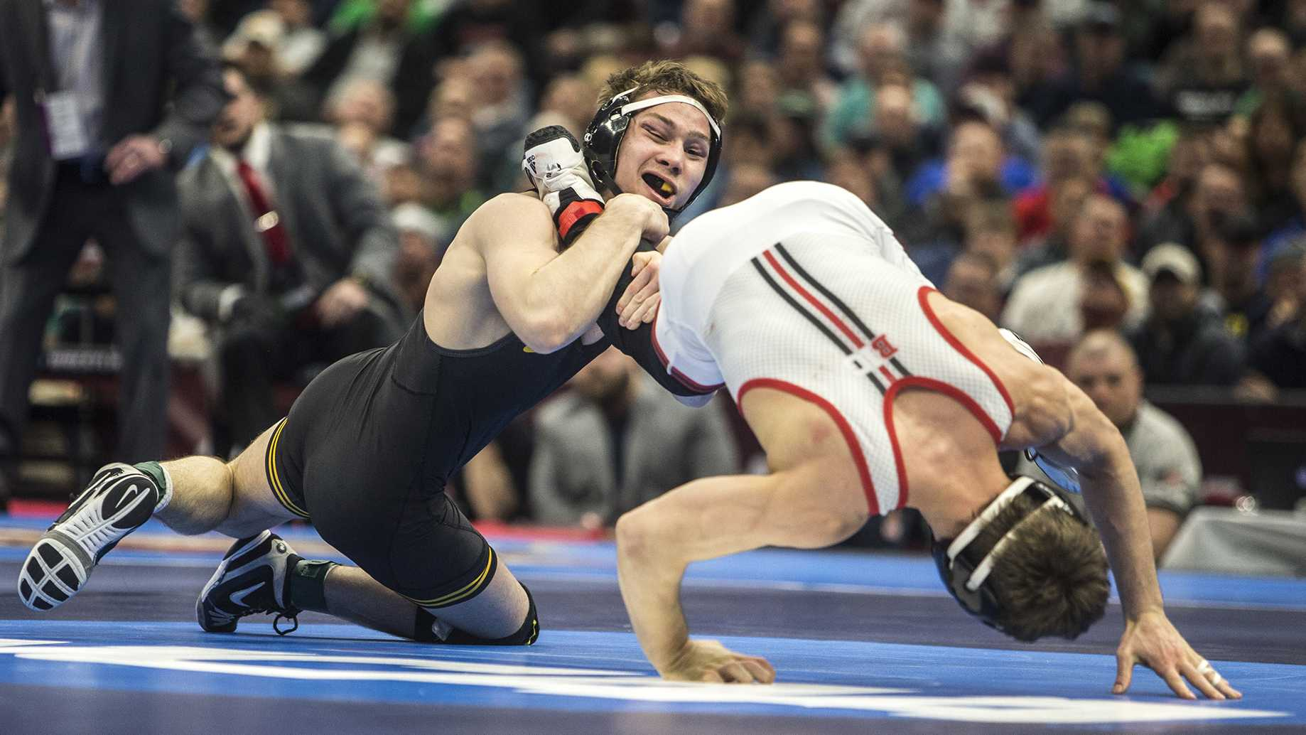 Iowa's Spencer Lee competes against Rutgers's Nick Suriano in the 125-pound final bout of the NCAA Wrestling Championships in Cleveland, OH. Lee defeated Suriano by decision, 5-1, placing first in the tournament. This is Lee's first national title. (Ben Allan Smith/The Daily Iowan)