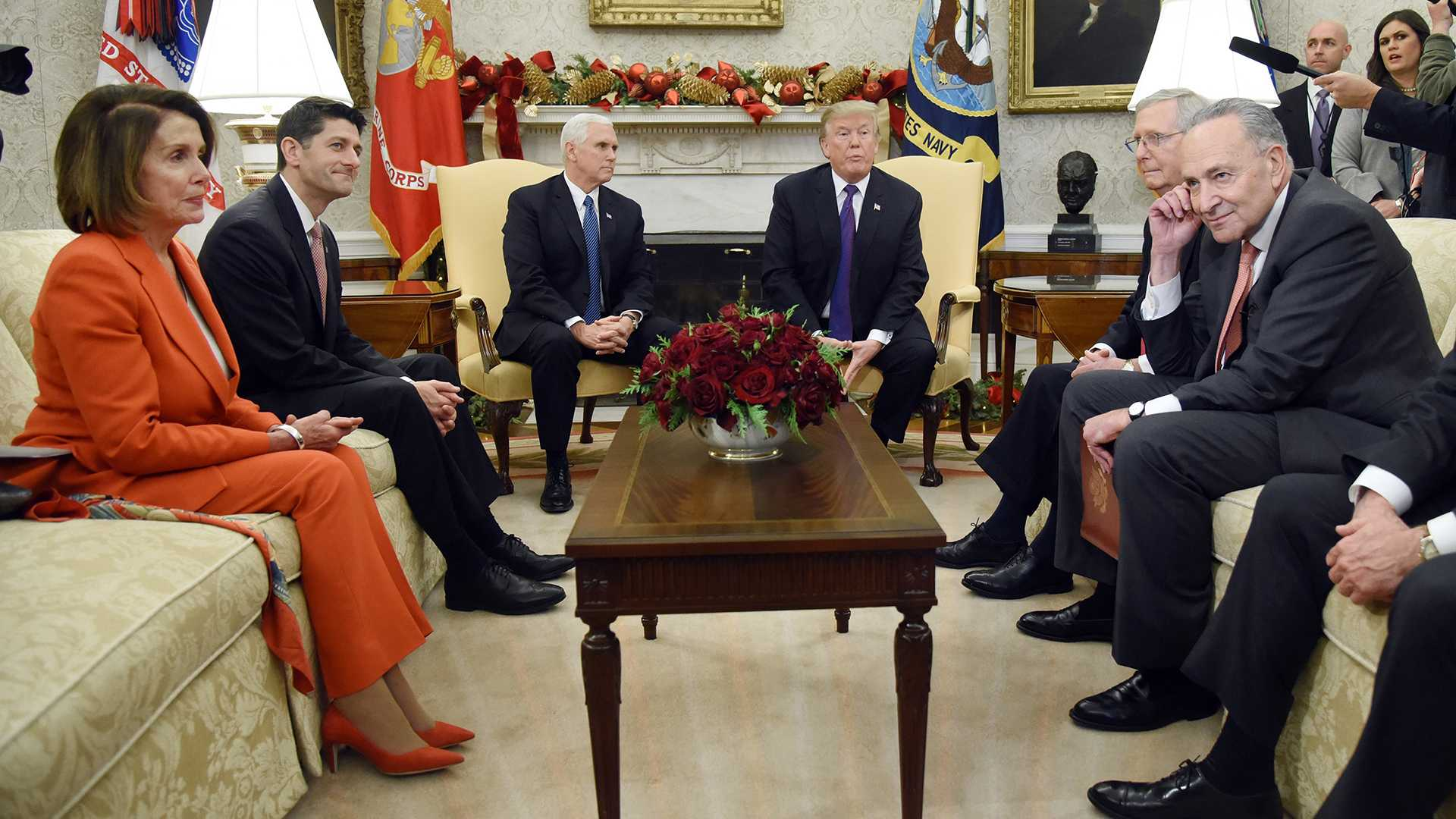 U.S. President Donald Trump and Vice President Mike Pence look on during a meeting with Congressional leadership including House Minority Leader Rep. Nancy Pelosi (D-Calif.), House Speaker Paul Ryan (R-Wis.), Senate Majority Leader Mitch McConnell, and Sen. Charles Schumer (D-NY) in the Oval Office of the White House Thursday, Dec. 7, 2017 in Washington, D.C.  (Olivier Douliery/Abaca Press/TNS)