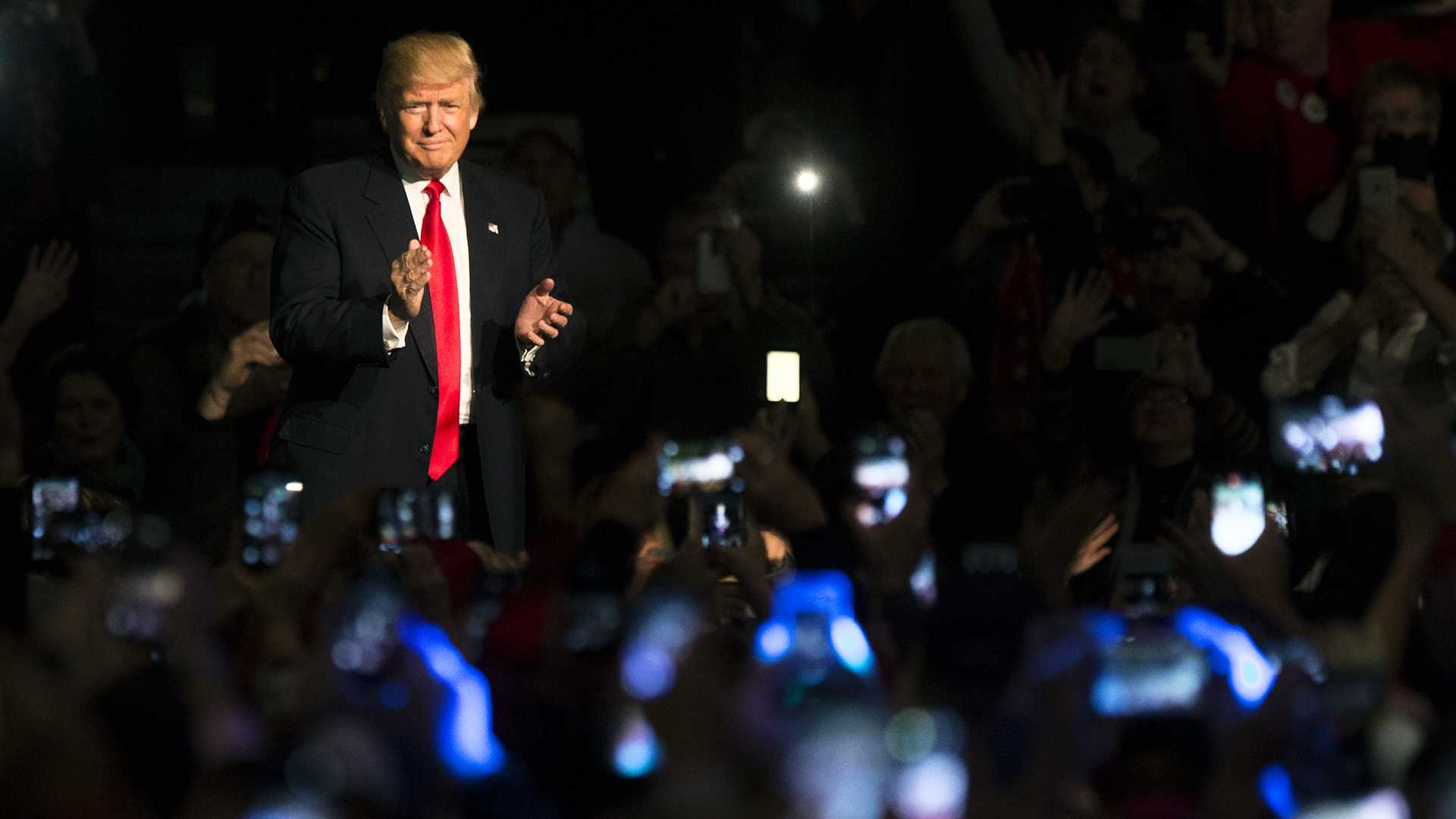 President-Elect Donald Trump thanks fans while making his entrance during an event for Trump and Vice President-Elect Mike Pence in Des Moines on Thursday, Dec. 8, 2016. (The Daily Iowan/Joseph Cress)