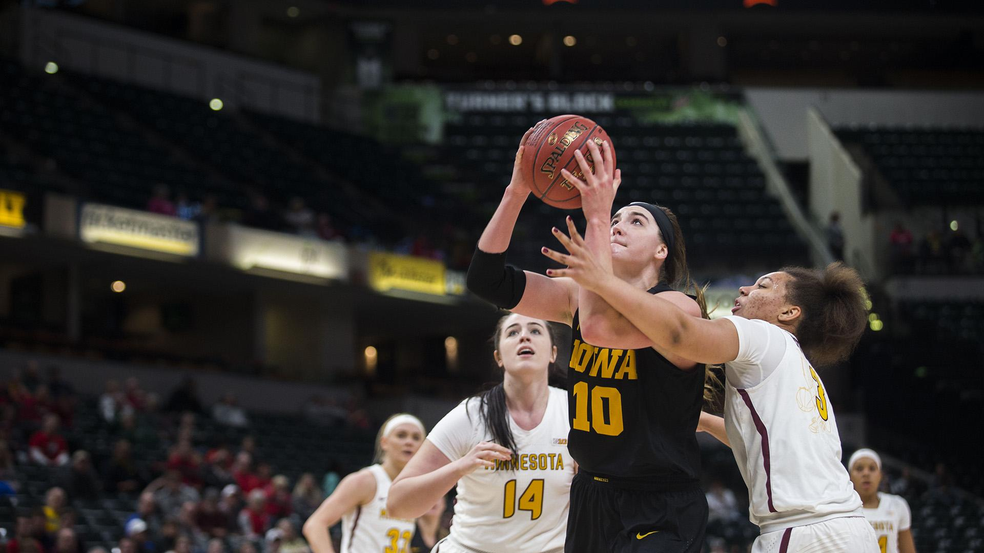 Iowa forward Megan Gustafson attempts a shot during the Iowa/Minnesota Big Ten tournament basketball game at Bankers Life Fieldhouse in Indianapolis on Friday, March, 2, 2018. The Golden Gophers defeated the Hawkeyes, 90-89. (Lily Smith/The Daily Iowan)