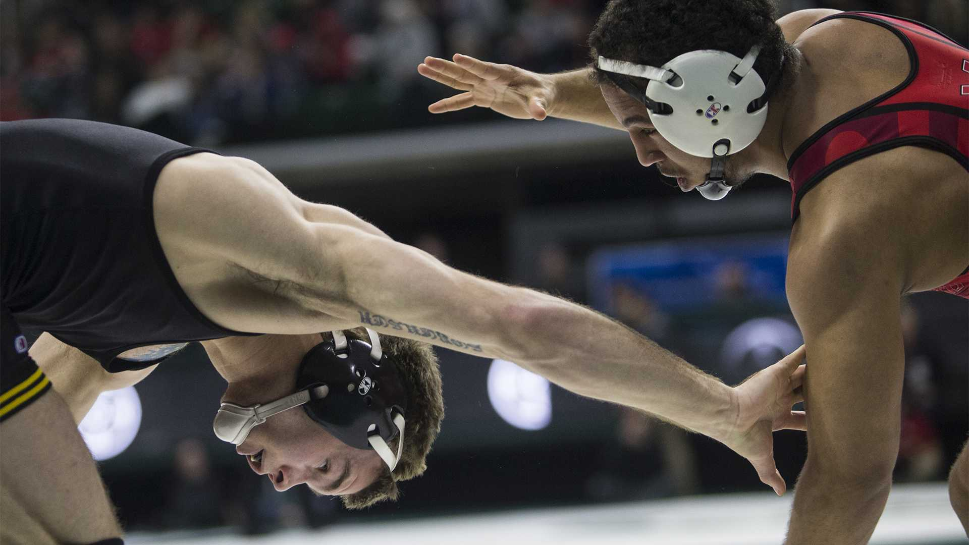 Iowa's 149-pound Brandon Sorensen reaches for Maryland's Alfred Bannister during Big Ten Wrestling Championships Day 1 at the Breslin Student Events Center in East Lansing, MI on Saturday, Mar. 3, 2018. Sorensen won in a decision, 4-3. (Ben Allan Smith/The Daily Iowan)