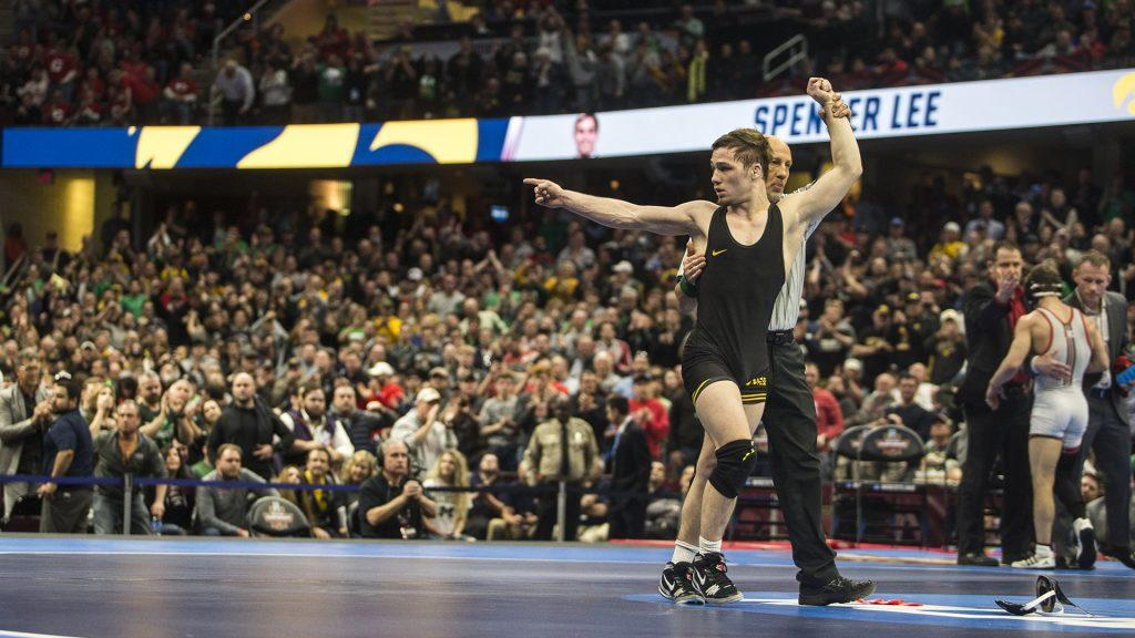 Iowa%27s+Spencer+Lee+competes+against+Rutgers%27s+Nick+Suriano+in+the+125-pound+final+bout+of+the+NCAA+Wrestling+Championships+in+Cleveland%2C+OH.+Lee+defeated+Suriano+by+decision%2C+5-1%2C+placing+first+in+the+tournament.+This+is+Lee%27s+first+national+title.+%28Ben+Allan+Smith%2FThe+Daily+Iowan%29