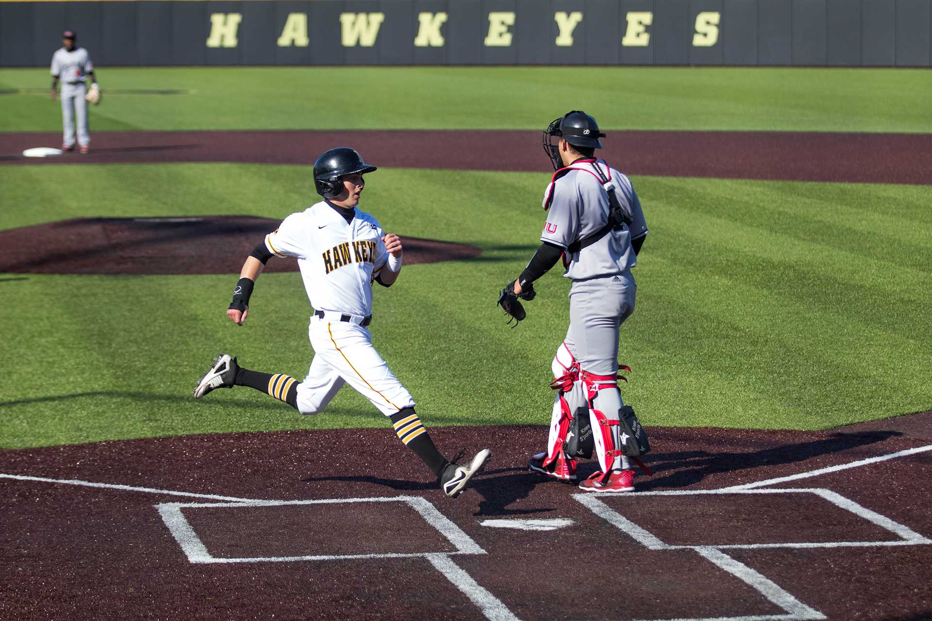 Tyler Cropley scores a run during Iowa baseball vs. Northern Illinois at Banks Field on April 17, 2018. The Hawkeyes won the game 2-0. (Megan Nagorzanski/The Daily Iowan)