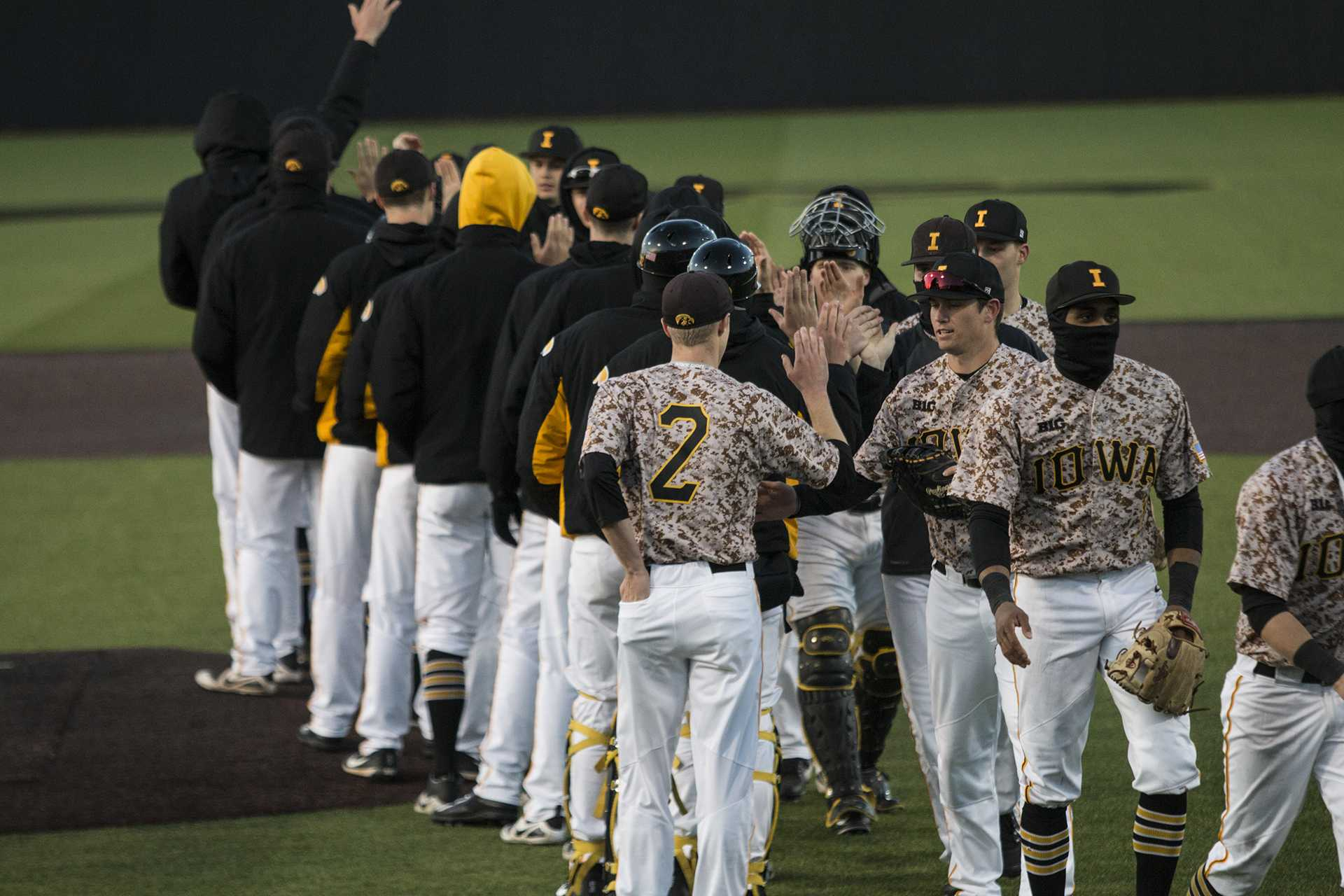 Iowa players congratulate each other during men's baseball Iowa vs. OSU at Duane Banks Field on April 7, 2018. The Hawkeyes defeated the Buckeyes 9-5. (Katina Zentz/The Daily Iowan)