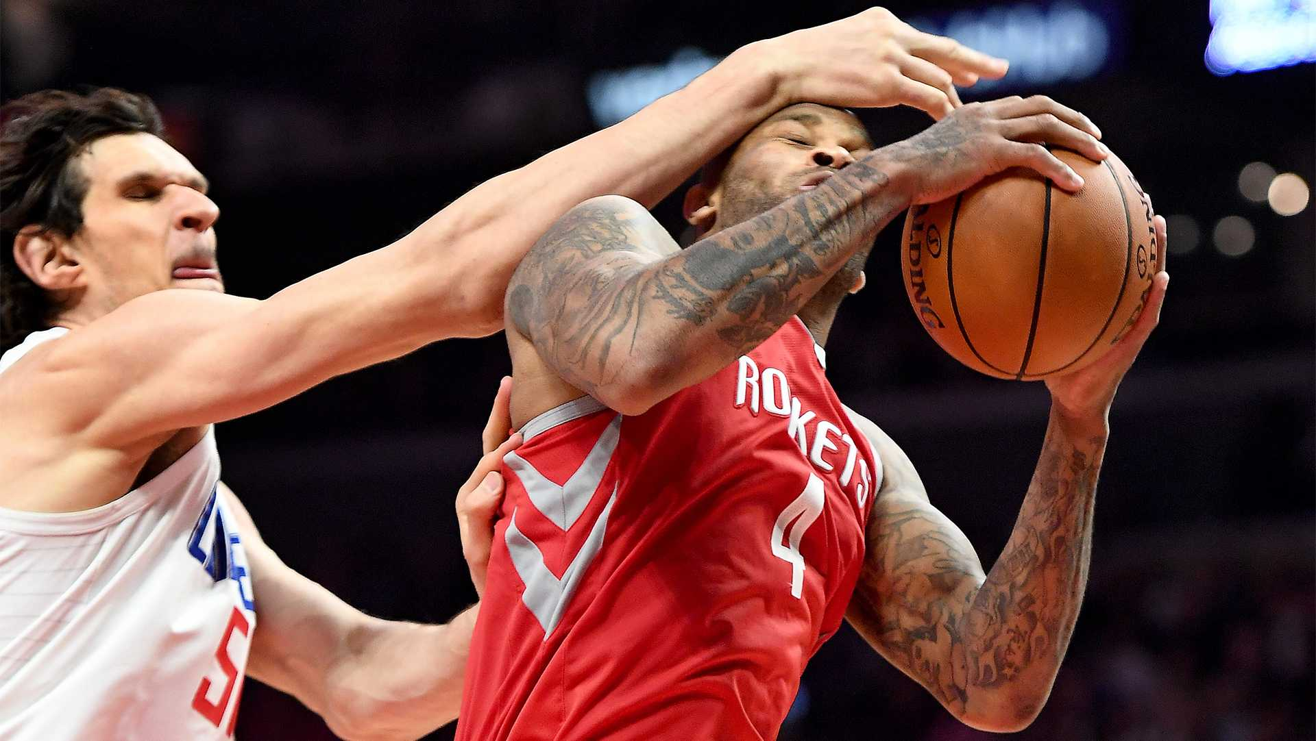 The Houston Rockets' P.J. Tucker (4) is fouled by the Los Angeles Clippers' Boban Marjanovic while grabbing a rebound at the Staples Center in Los Angeles on Wednesday, Feb. 28, 2018. (Wally Skalij/Los Angeles Times/TNS)