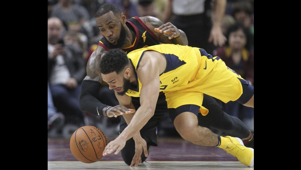 Cleveland+Cavaliers%26apos%3B+LeBron+James+and+Indiana+Pacers%26apos%3B+Cory+Joseph+go+after+a+fourth+quarter+lose+ball+in+an+Eastern+Conference+first+round+game+on+Sunday%2C+April+15%2C+2018+at+Quicken+Loans+Arena+in+Cleveland%2C+Ohio.+The+Cavs+lost+the+game%2C+98-80.+%28Phil+Masturzo%2FAkron+Beacon+Journal%2FTNS%29