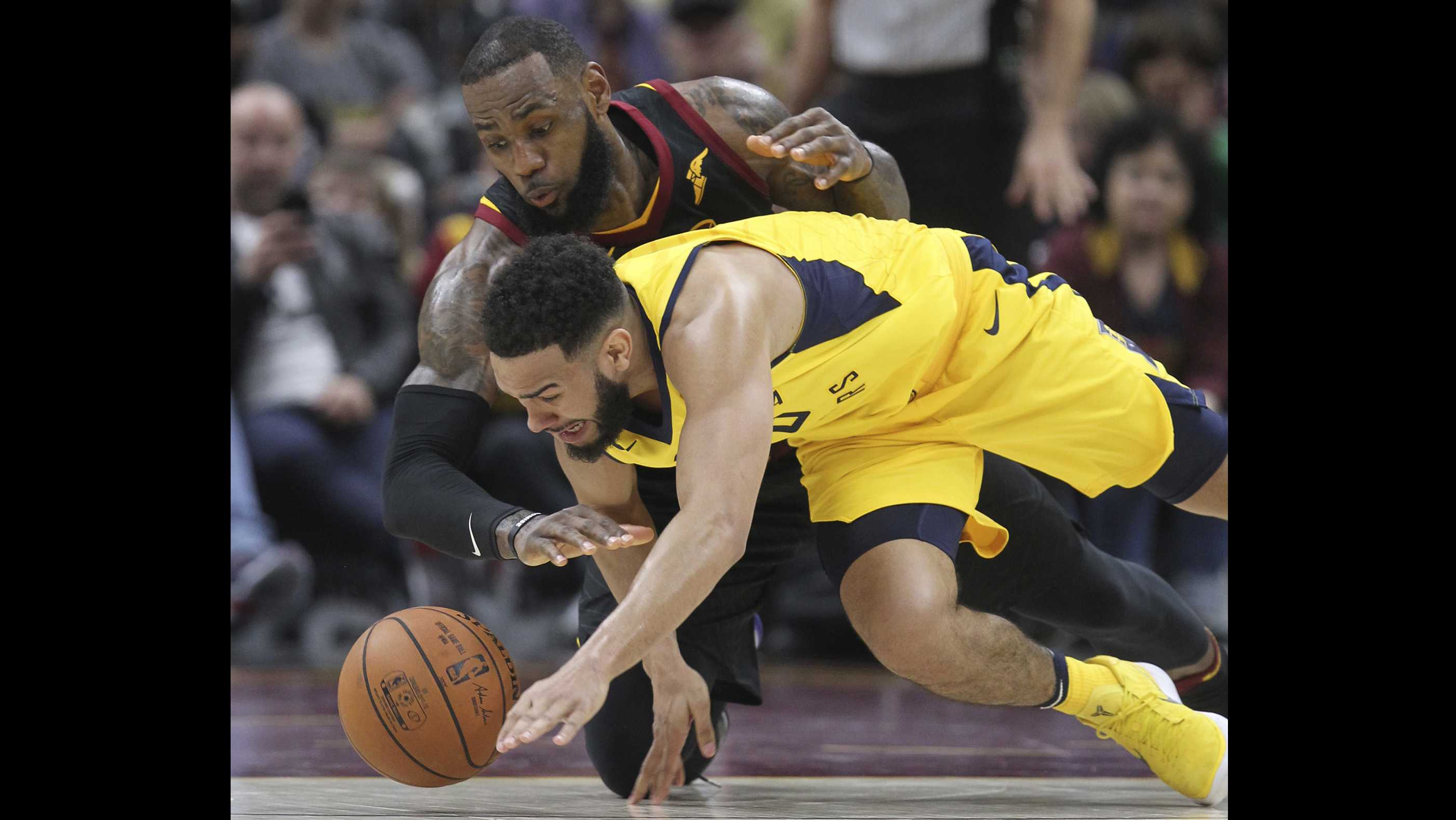 Cleveland Cavaliers' LeBron James and Indiana Pacers' Cory Joseph go after a fourth quarter lose ball in an Eastern Conference first round game on Sunday, April 15, 2018 at Quicken Loans Arena in Cleveland, Ohio. The Cavs lost the game, 98-80. (Phil Masturzo/Akron Beacon Journal/TNS)