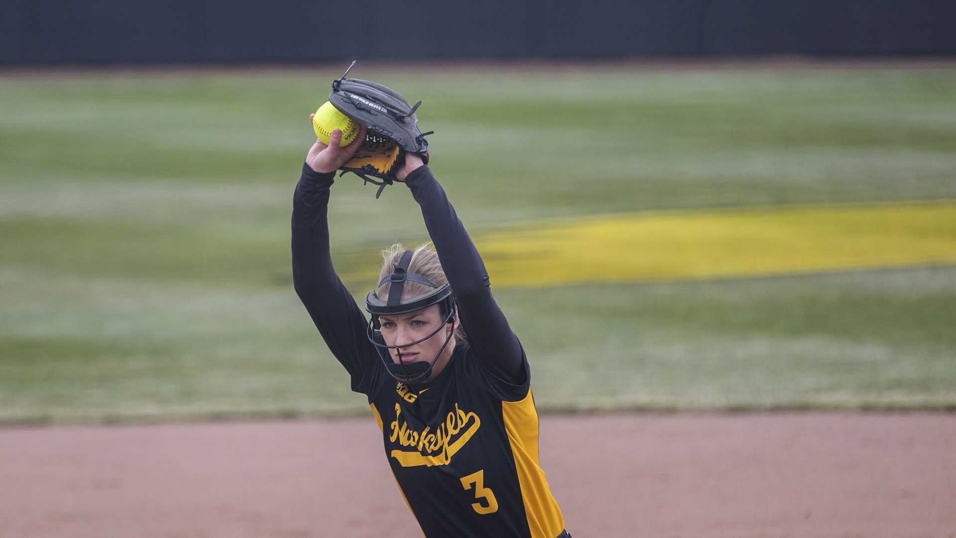 Iowa's Allison Doocy pitches during the Iowa/Wisconsin softball game at Bob Pearl Field  on Sunday, April 8, 2018. The Hawkeyes defeated the Badgers in the third game of the series, 5-3. (Lily Smith/The Daily Iowan)