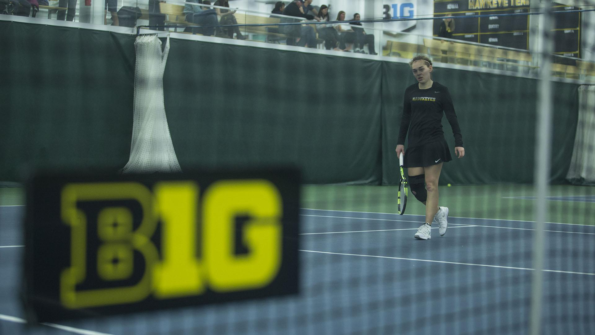 Iowa's Zoe Douglas reacts during a tennis match between Iowa and Ohio State in Iowa City on Sunday, March 25, 2018. The Buckeyes swept the doubles point and won the match, 6-1. (Shivansh Ahuja/The Daily Iowan)