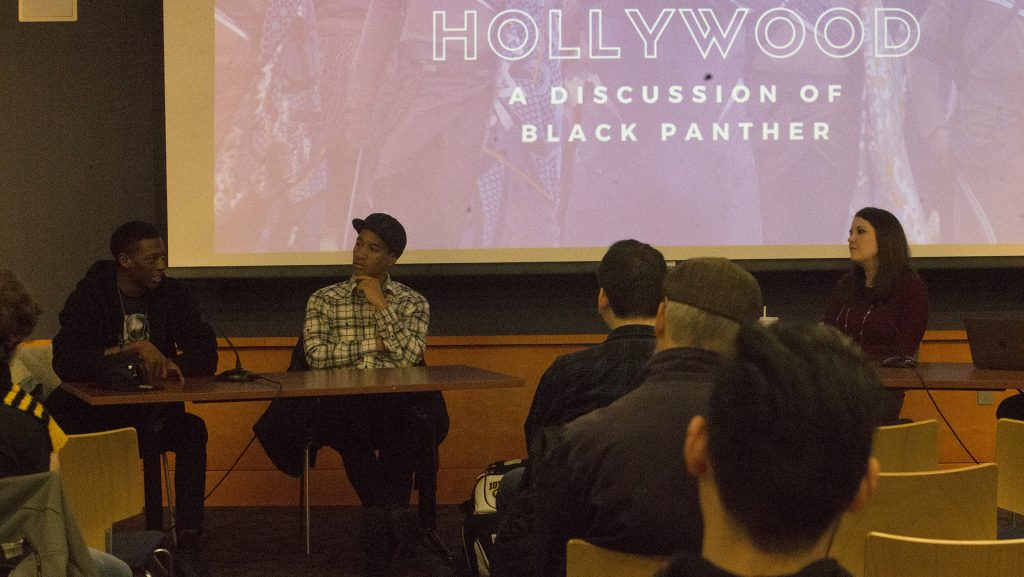 Panelists+address+the+impact+of+Black+Panther+within+the+African-American+community+during+the+Wakanda+to+Hollywood+panel+at+the+Iowa+City+Public+Library+on+April+15%2C+2018.+The+panel+discussed+the+importance+of+the+Black+Panther+film+and+how+it+related+to+other+superhero+movies.+%28Ashol+Aguek%2FThe+Daily+Iowan%29
