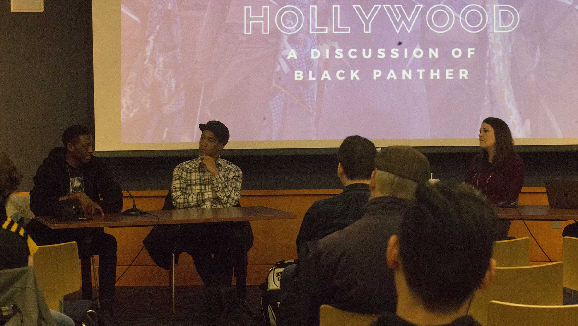Panelists address the impact of Black Panther within the African-American community during the Wakanda to Hollywood panel at the Iowa City Public Library on April 15, 2018. The panel discussed the importance of the Black Panther film and how it related to other superhero movies. (Ashol Aguek/The Daily Iowan)