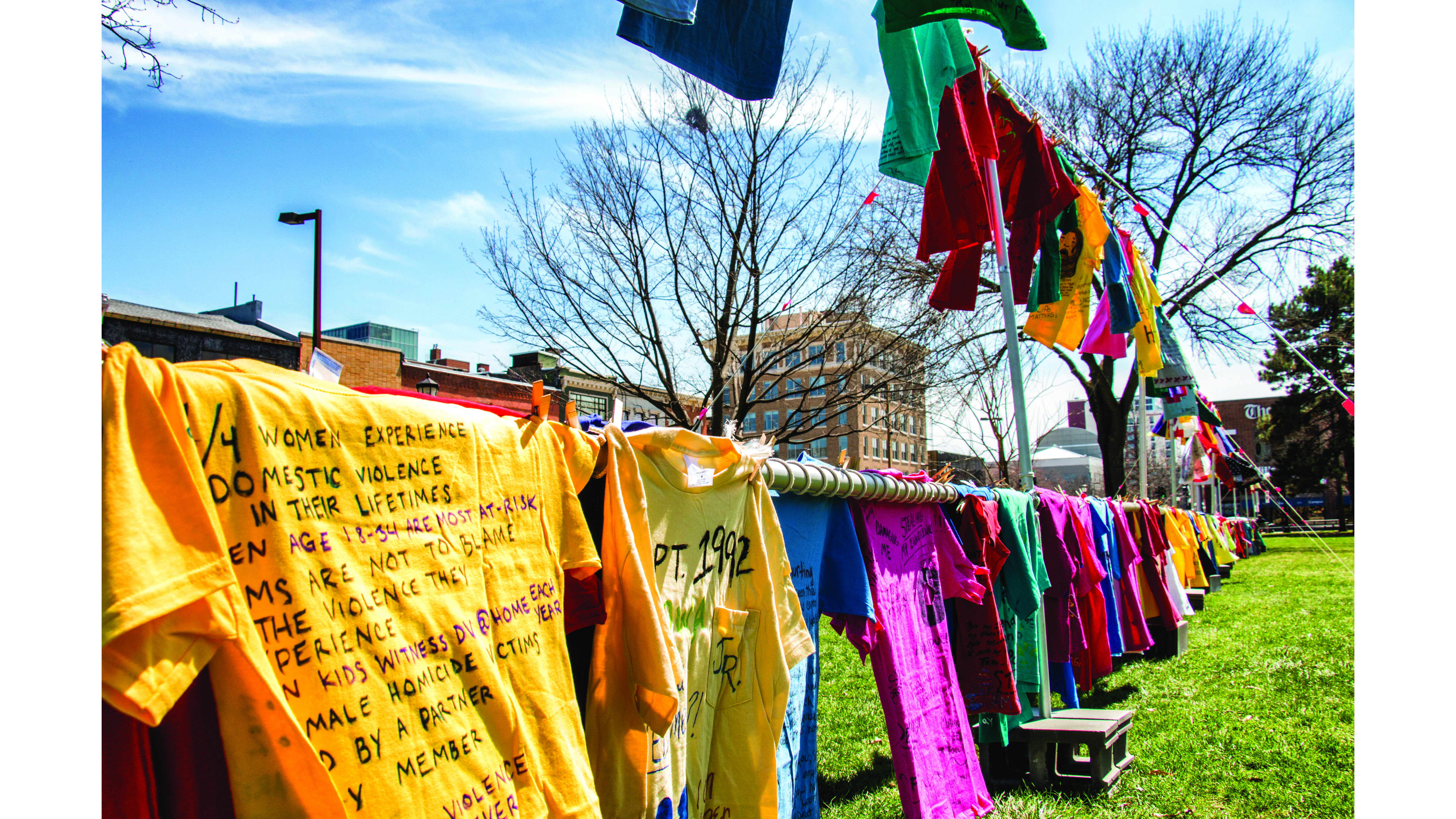 T-shirts hang outside during the RVAP Clothesline Project at the Pentacrest on April 25, 2018. The project emphasized the impact that sexual assault, domestic violence, and homophobic violence has on victims. (Katina Zentz/The Daily Iowan)